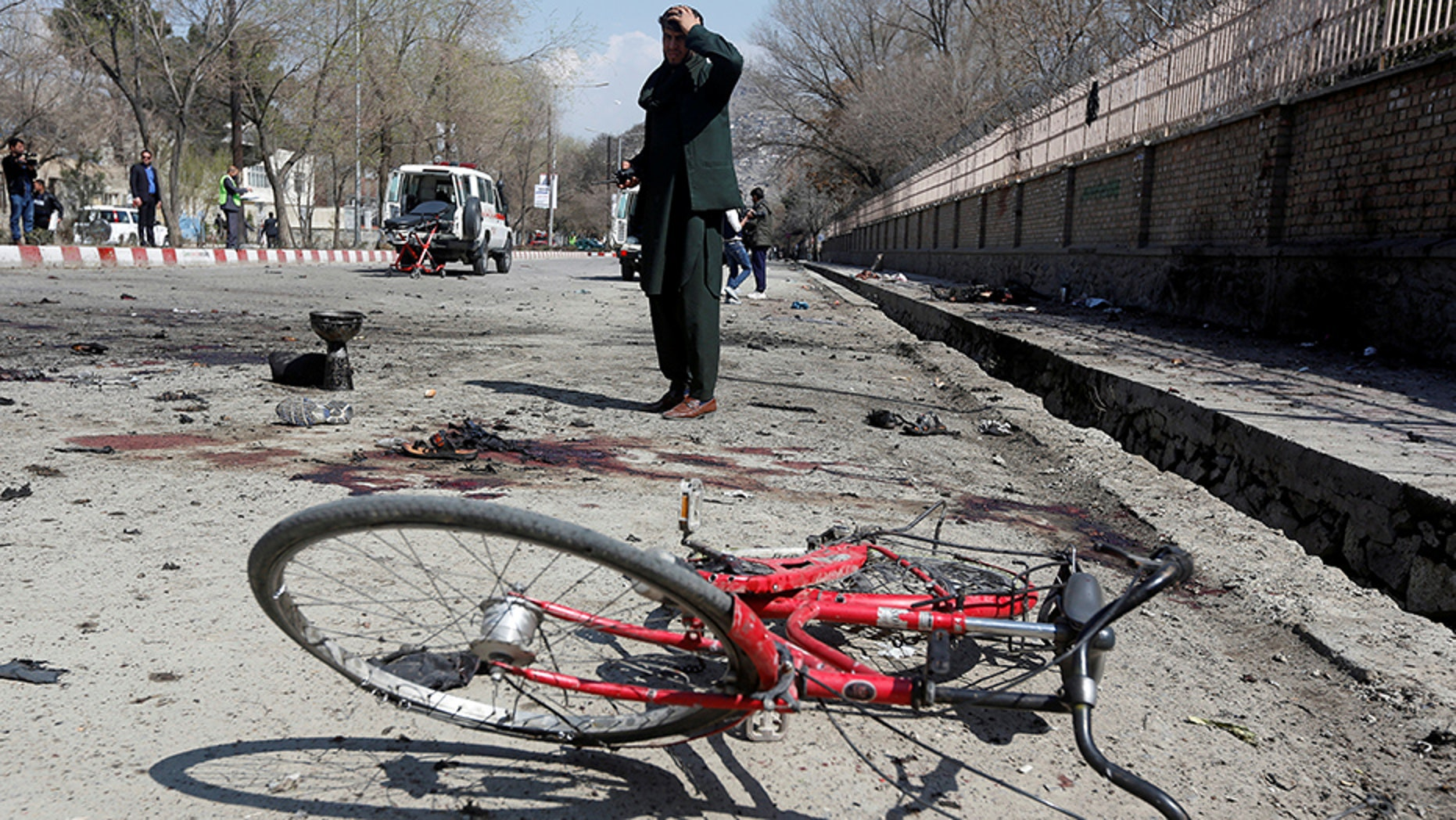 An Afghan man inspects the site of a suicide attack in Kabul, Afghanistan March 21, 2018. REUTERS/Omar Sobhani - RC1162C40DF0
