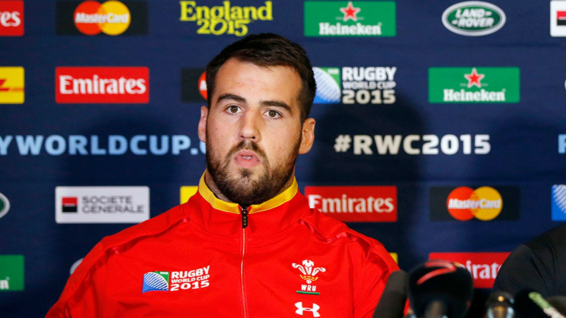 Welsh rugby player Scott Baldwin was forced to miss a match in South Africa after he was bitten by a lion.