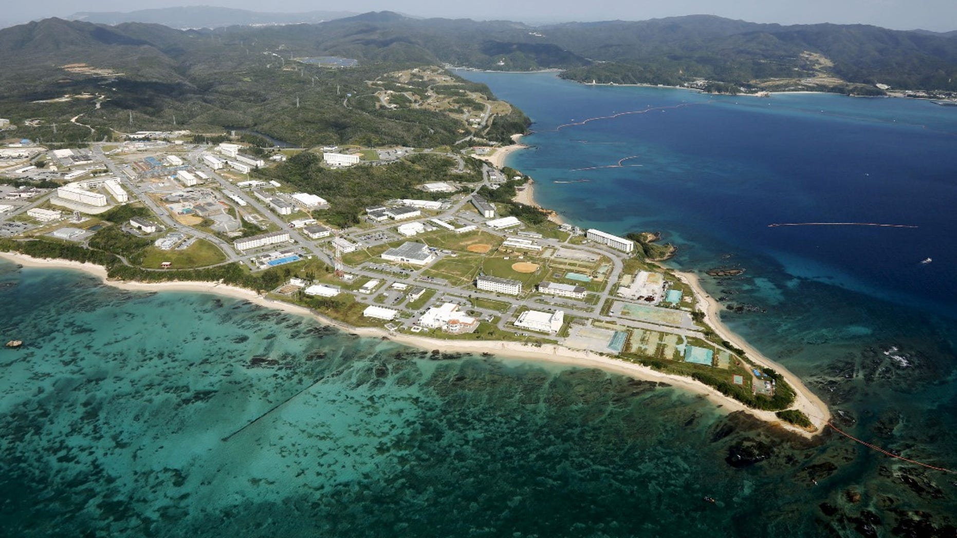 FILE -- Coral reefs are seen along the coast near the U.S. Marine base Camp Schwab, off the tiny hamlet of Henoko in Nago, on the southern Japanese island of Okinawa, in this file aerial photo taken by Kyodo October 29, 2015 file photo.