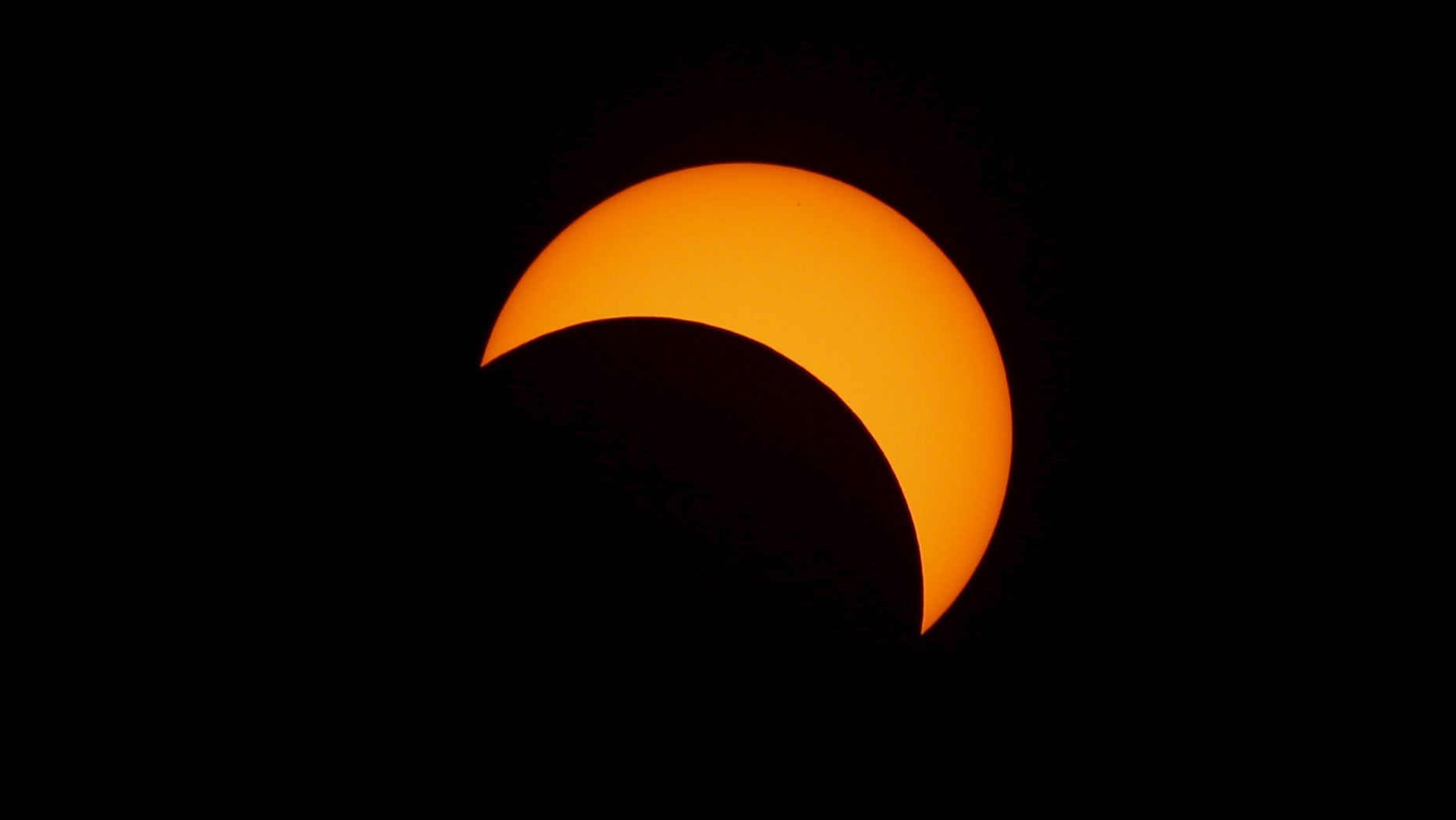 A solar eclipse is seen from the beach of Ternate island, Indonesia, March 9, 2016.