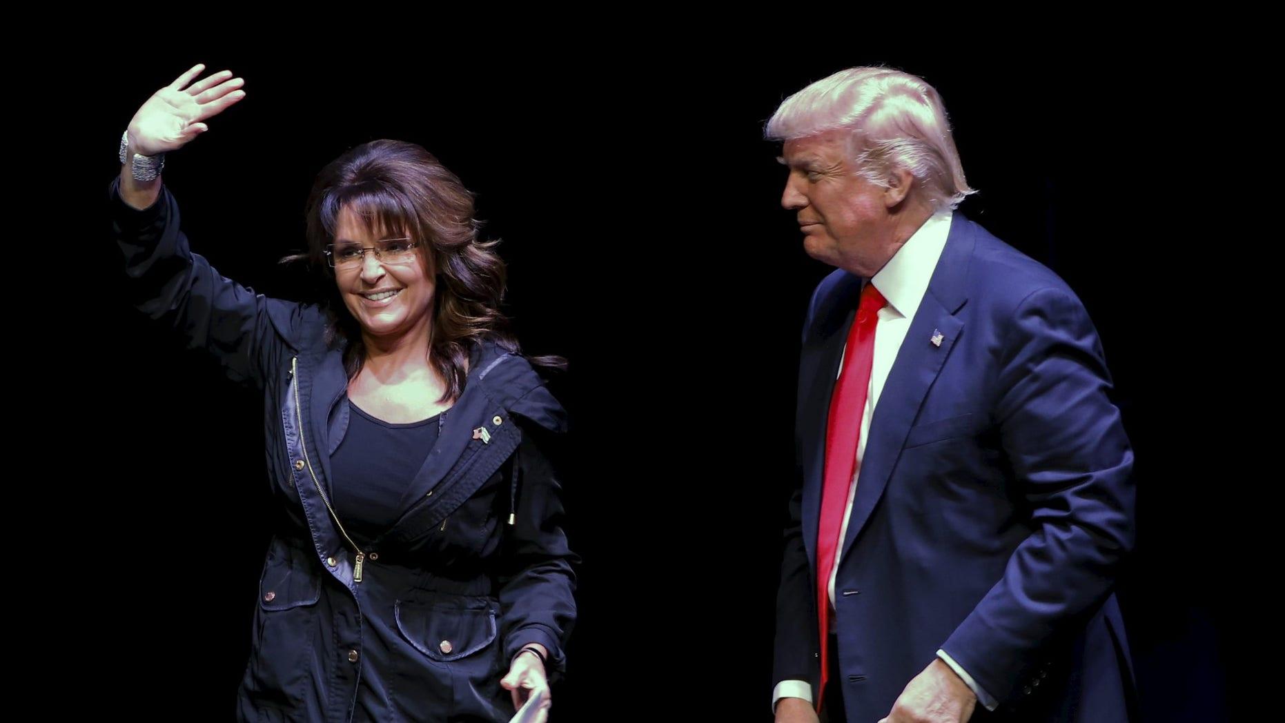 FILE -- Former Alaska Governor Sarah Palin (L), introduces President Donald Trump during a Town Hall at the Racine Civic Centre Memorial Hall, April 2, 2016.