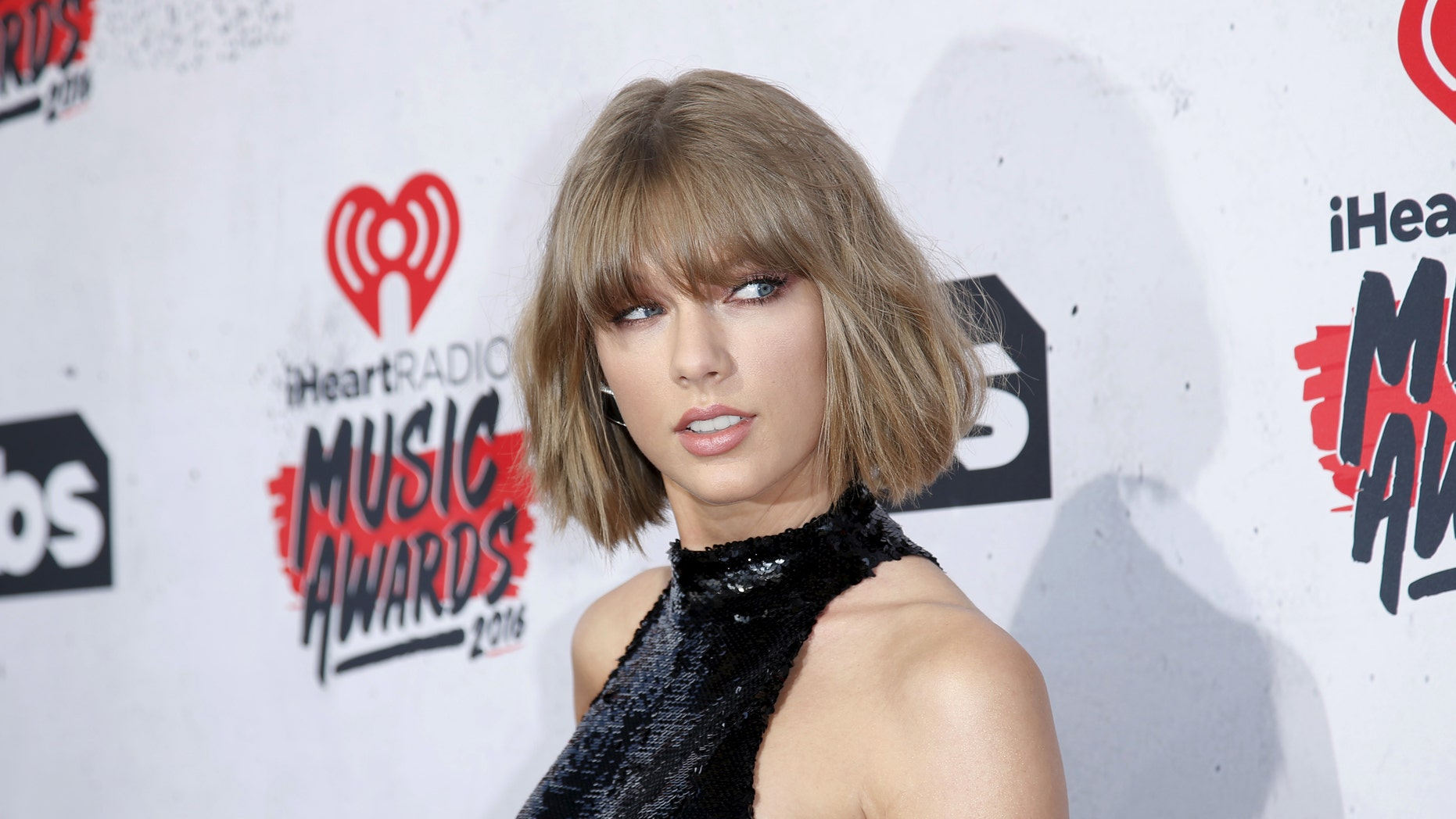Taylor Swift poses at the 2016 iHeartRadio Music Awards in Inglewood, California, April 3, 2016.