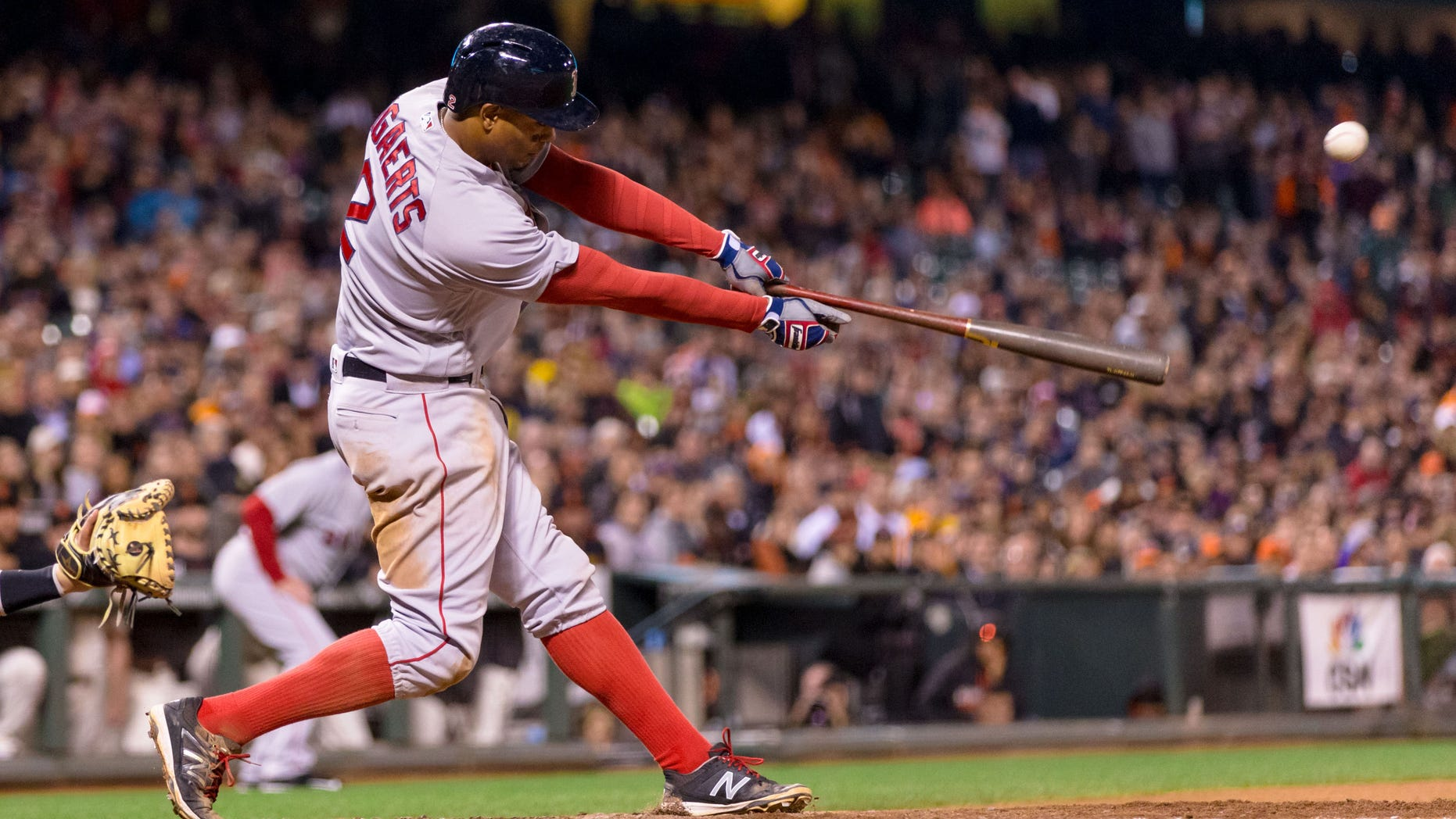 Boston Red Sox shortstop Xander Bogaerts (2) hits a two run single against the San Francisco Giants in the tenth inning at AT&T Park on Jun 7, 2016.