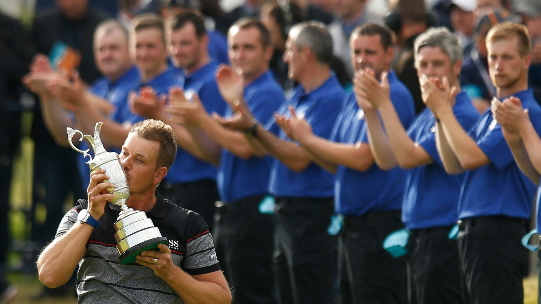 Sweden's Henrik Stenson celebrates winning the British Open.