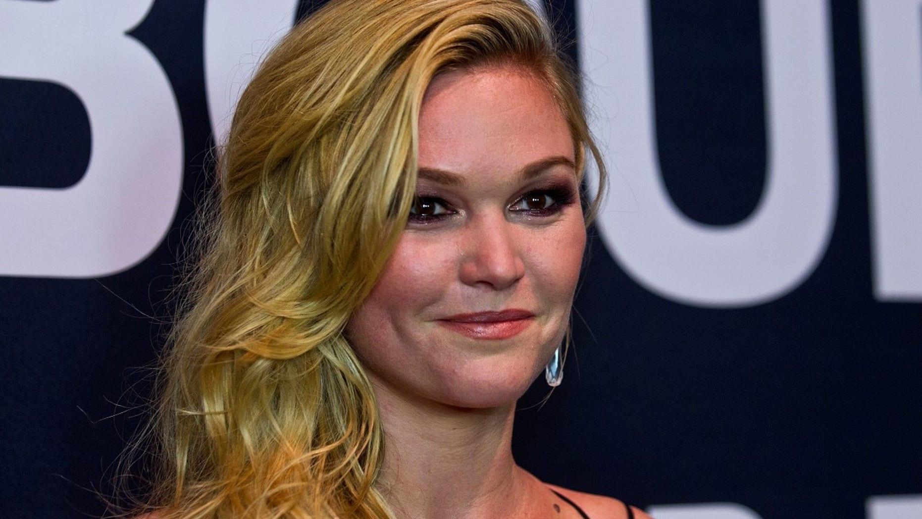 Julia Stiles hit back at mom-shamers who accused her of holding her newborn son incorrectly.