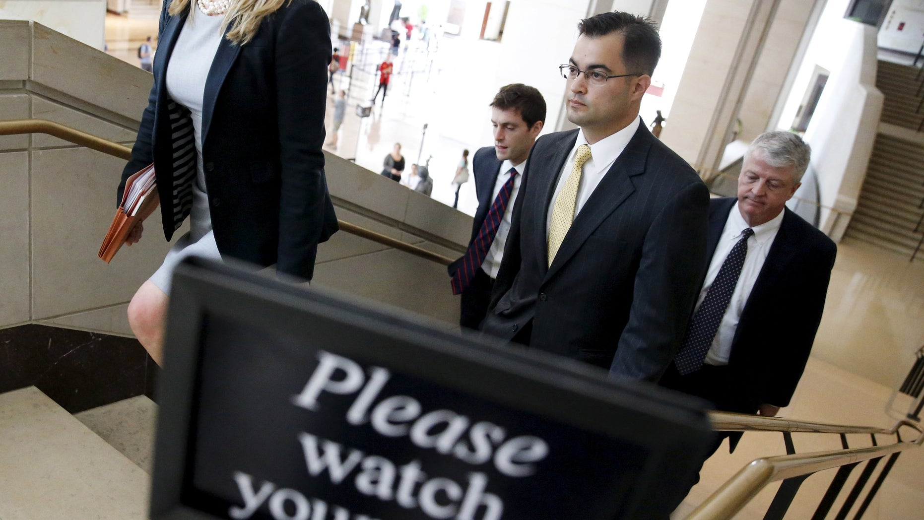 Sept. 10, 2015: Bryan Pagliano (2nd R), aide to former U.S. Secretary of State Hillary Clinton, departs with his legal team after appearing at a private session of the House Select Committee on Benghazi at the U.S. Capitol in Washington.
