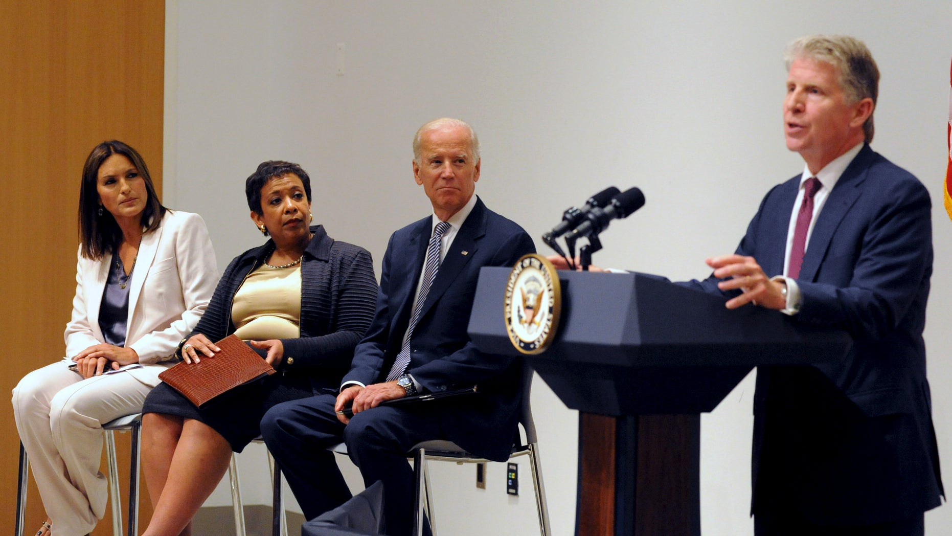 """Manhattan District Attorney Cyrus R. Vance (R) speaks at the podium as U.S. Vice President Joe Biden and U.S. Attorney General Loretta B. Lynch look on with actress Mariska Hargitay (L) during an news conference in New York, September 10, 2015. The three were announcing the award of approximately $80 million in grants to eliminate backlogs of untested sexual assault evidence kits or """"rape kits."""""""