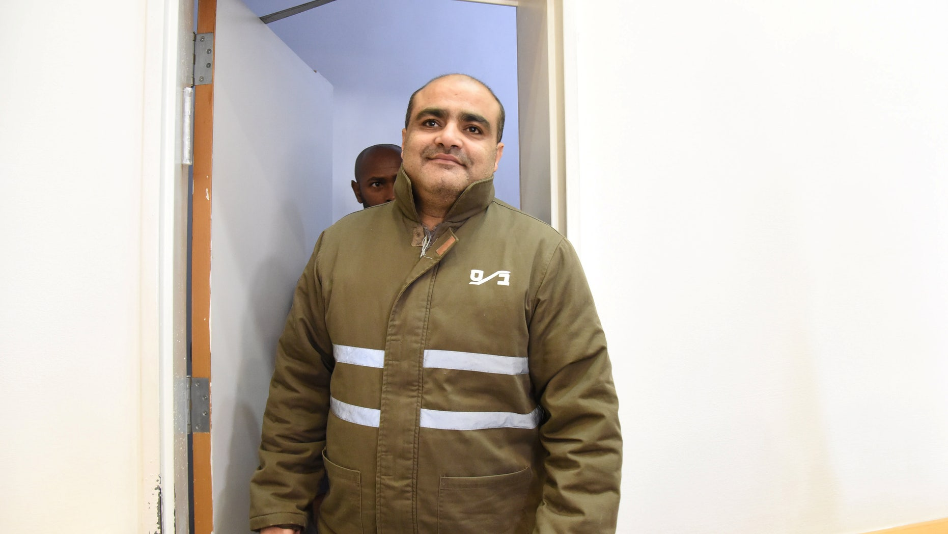 Mohammed el-Halabi in a courtroom in southern Israel.