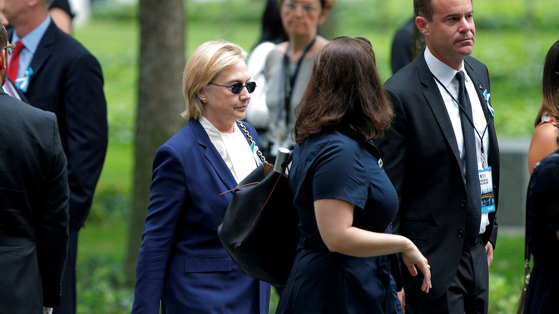 U.S. Democratic presidential candidate Hillary Clinton arrives for ceremonies to mark the 15th anniversary of the September 11 attacks at the National 9/11 Memorial in New York, New York, United States September 11, 2016.  REUTERS/Brian Snyder  - RTSN7US