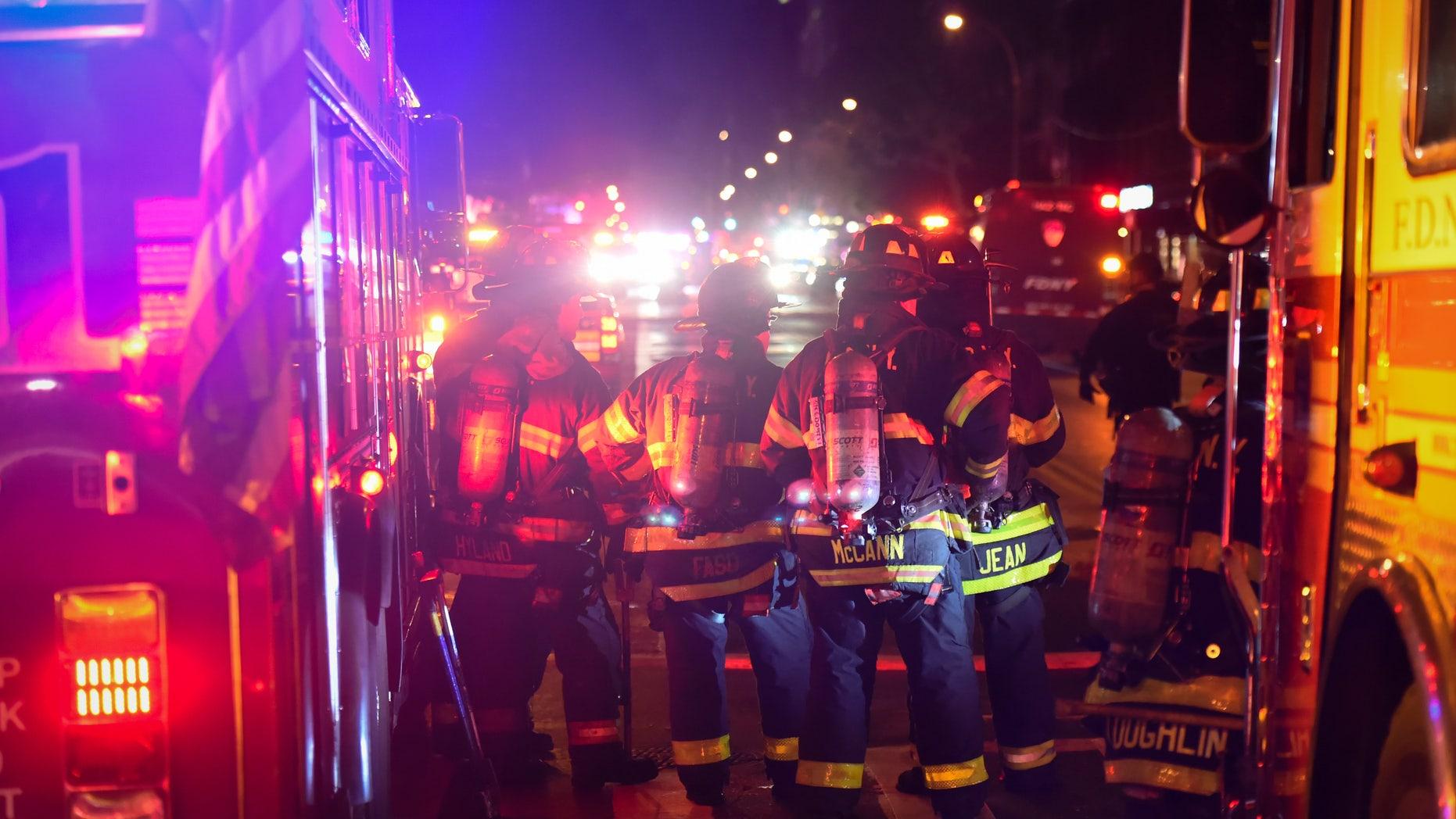 New York City firefighters stand near the site of an explosion in the Chelsea neighborhood of Manhattan, New York, U.S. September 17, 2016. (REUTERS/Rashid Umar Abbasi)