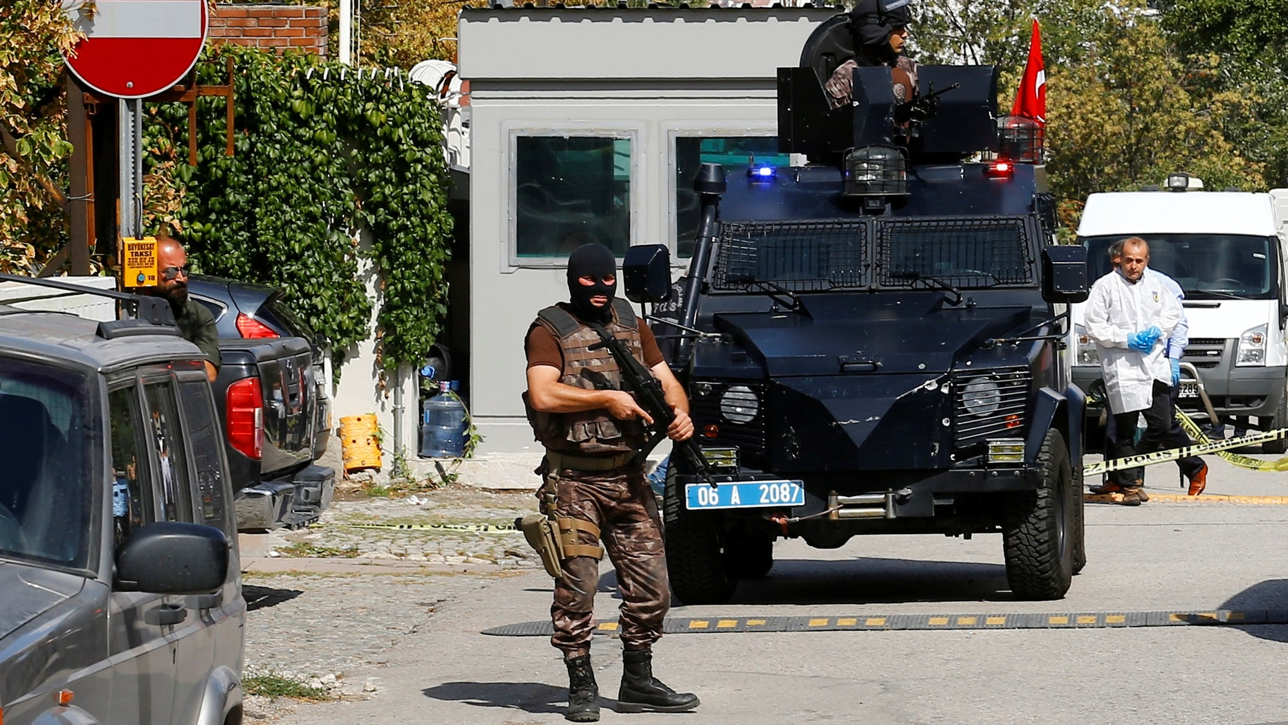 A member of police special forces stands guard in front of the Israeli Embassy in Ankara.