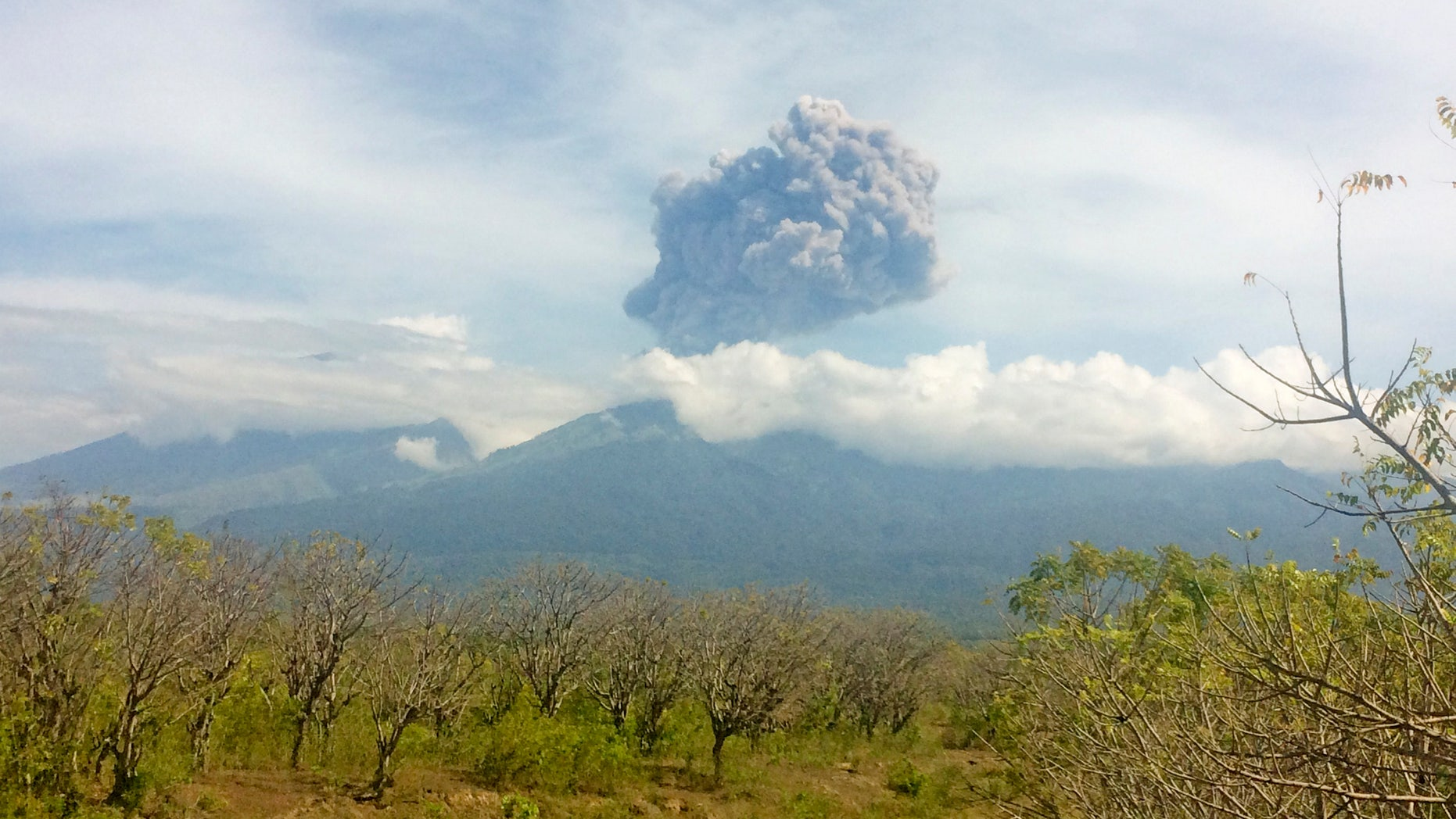 Mount Barujari, located inside Mount Rinjani volcano, is seen erupting from Bayan district, North Lombok, Indonesia.
