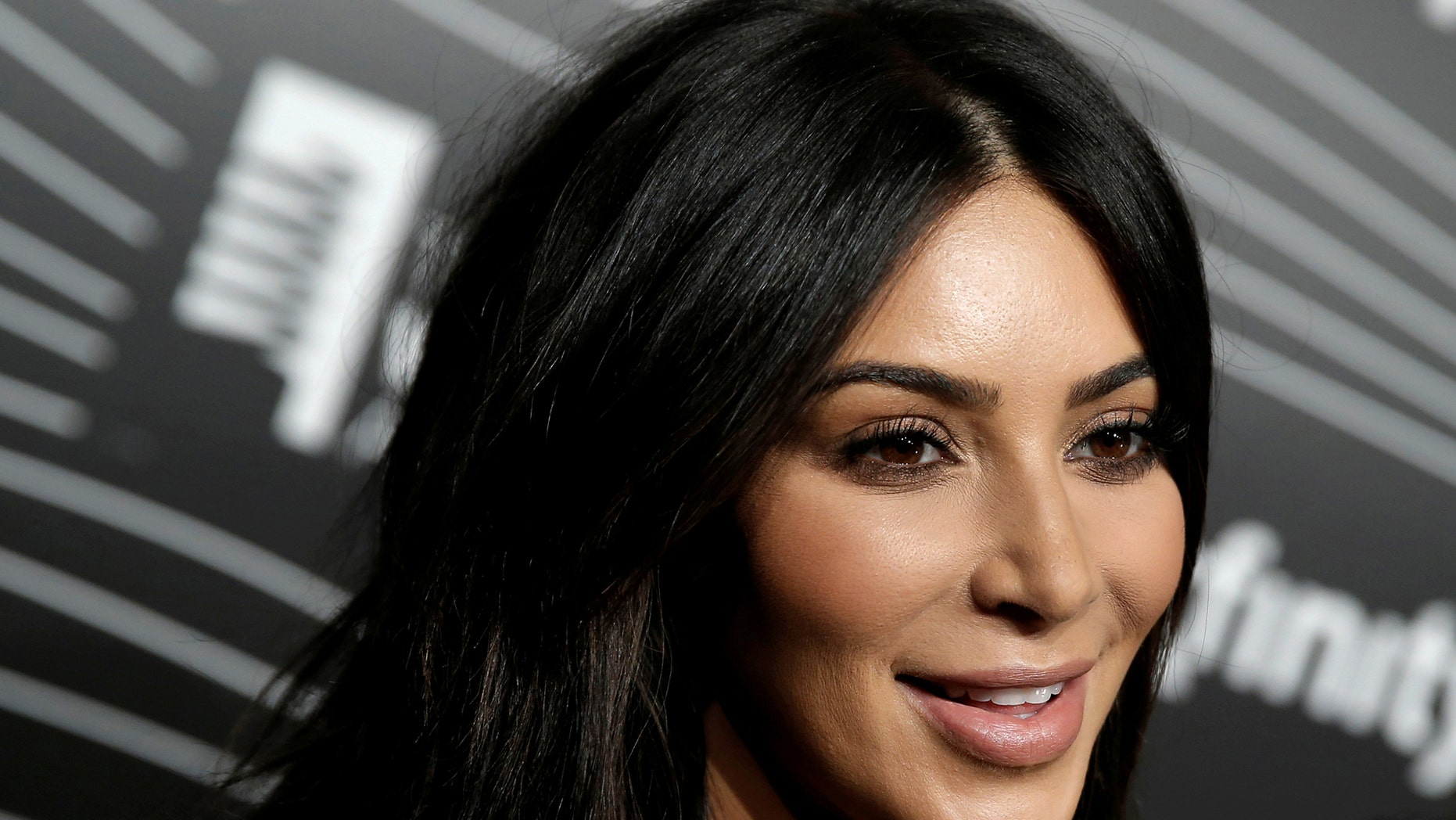 Kim Kardashian West participates in a television interview as she arrives for the 20th Annual Webby Awards in Manhattan, New York, U.S., May 16, 2016. REUTERS/Mike Segar/File Photo - RTSRT2M