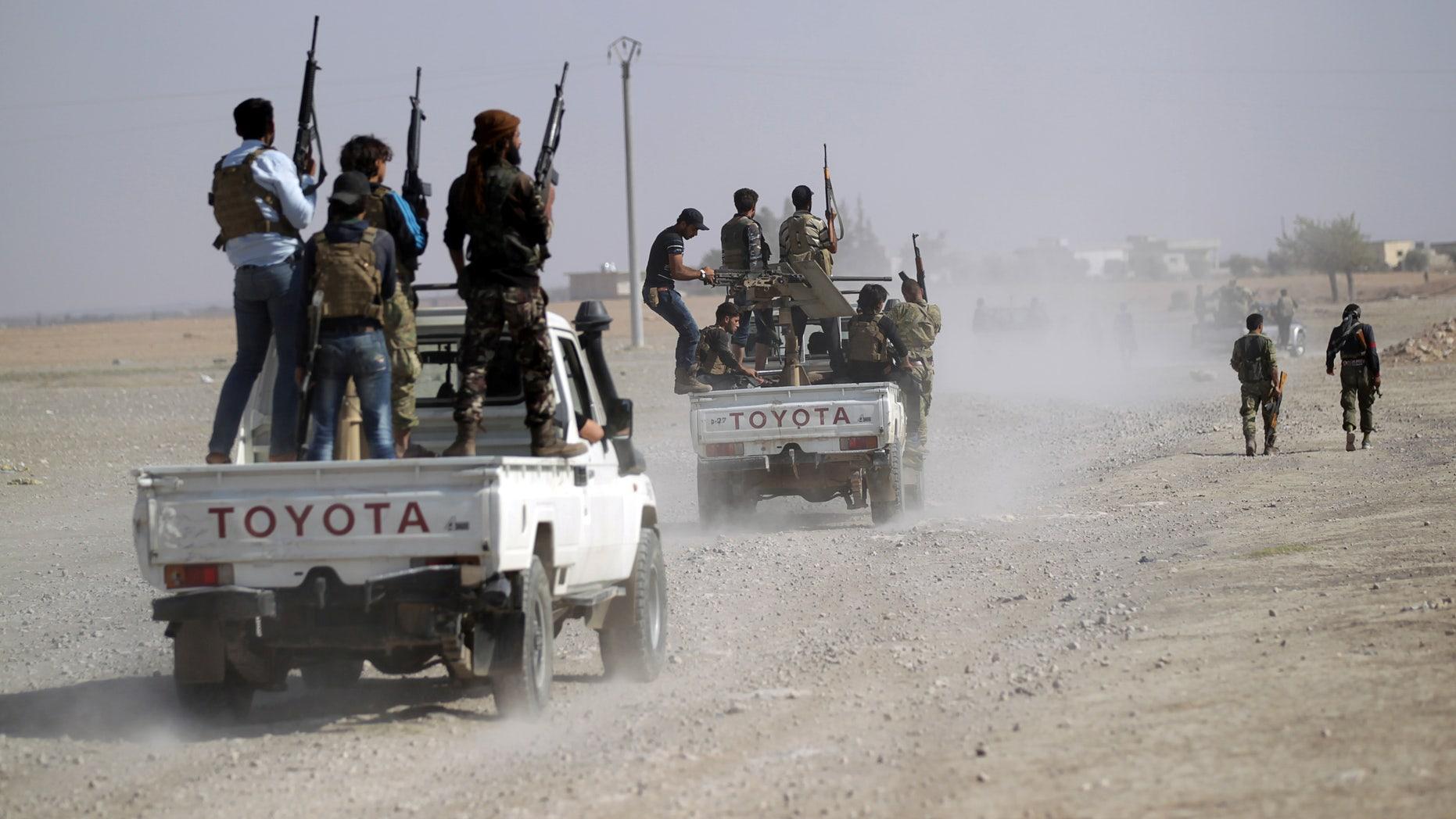 Rebel fighters near Azaz last October.