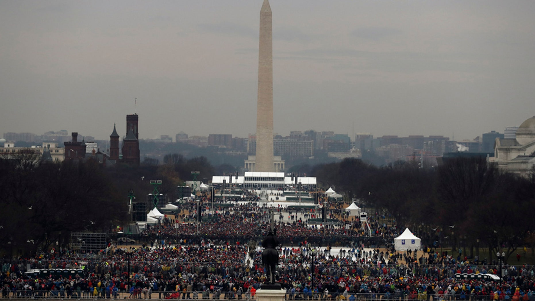 The statue of Civil War General and former US President Ulysses S. Grant faces the Washington Monument and the crowd gathering for the inauguration ceremonies to swear in Donald Trump as the 45th president of the United States at the U.S. Capitol in Washington, U.S., January 20, 2017.  REUTERS/Carlos Barria - RTSWGVS