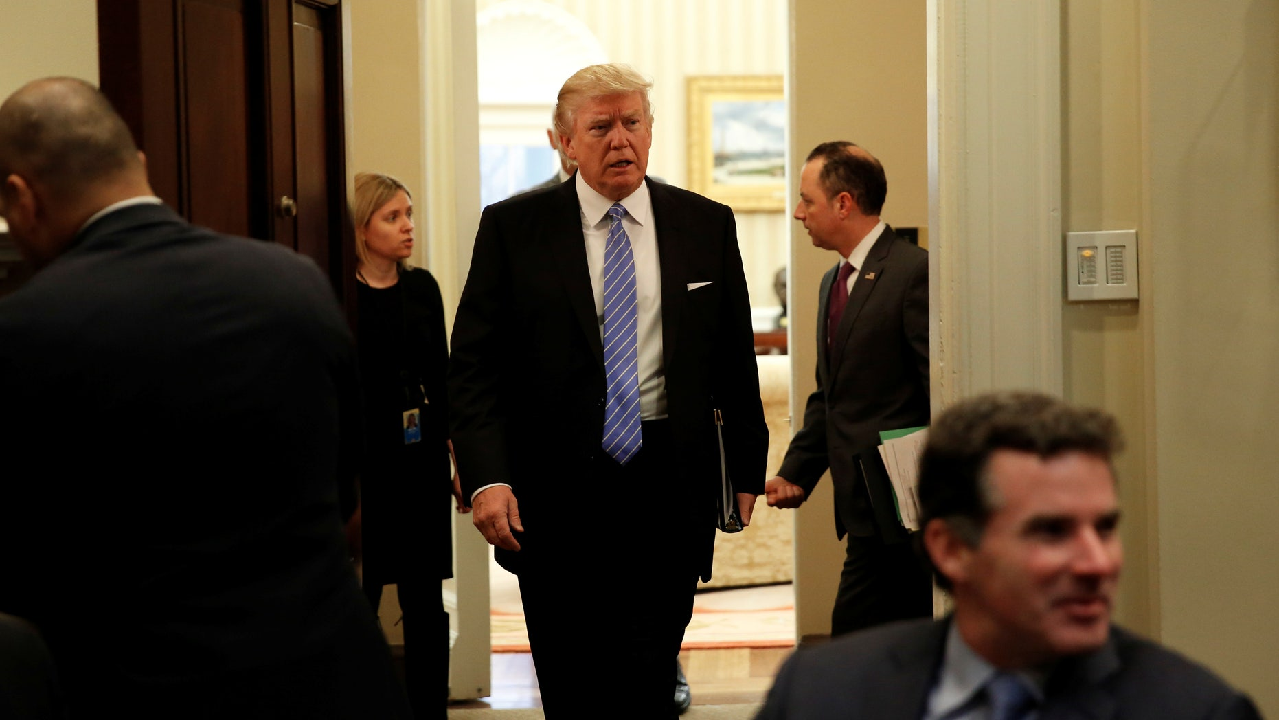 U.S. President Donald Trump arrives for a meeting with business leaders in the Roosevelt Room of the White House in Washington January 23, 2017. (REUTERS/Kevin Lamarque)