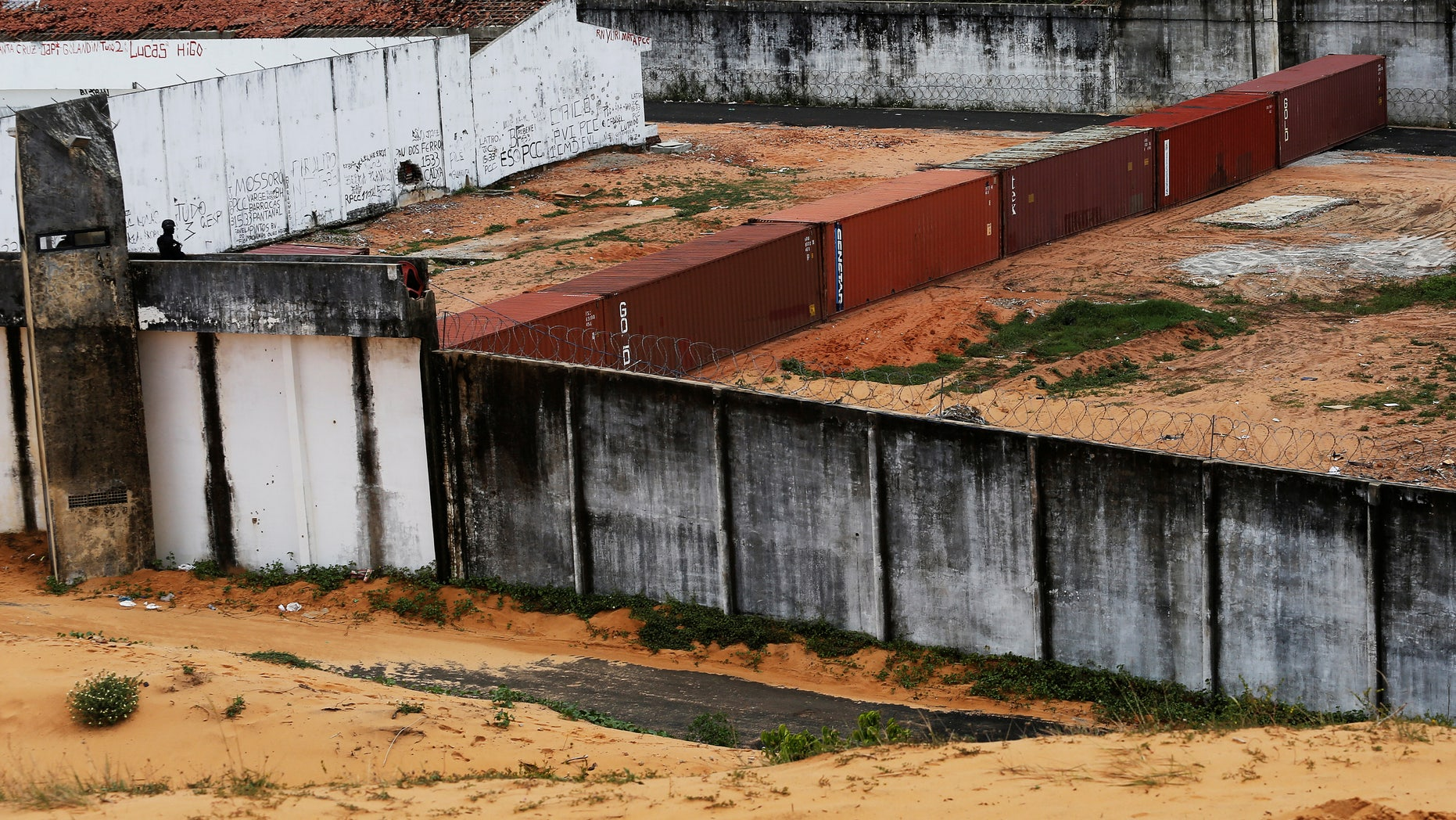 An improvised wall of shipping containers separate two factions of drug gangs at Alcacuz prison, Brazil.