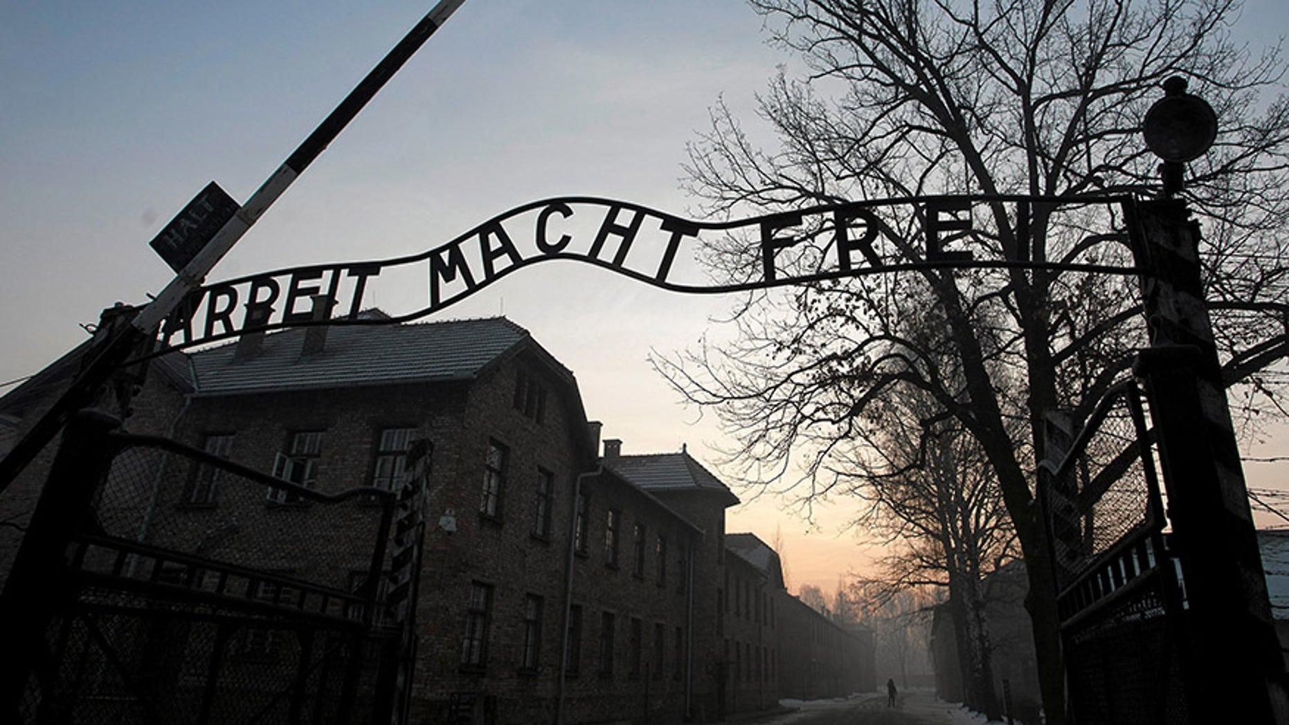 "The Nazi slogan ""Arbeit macht frei"" (Work sets you free) is pictured at the gates of the former Nazi German concentration and extermination camp Auschwitz-Birkenau in Oswiecim, Poland."