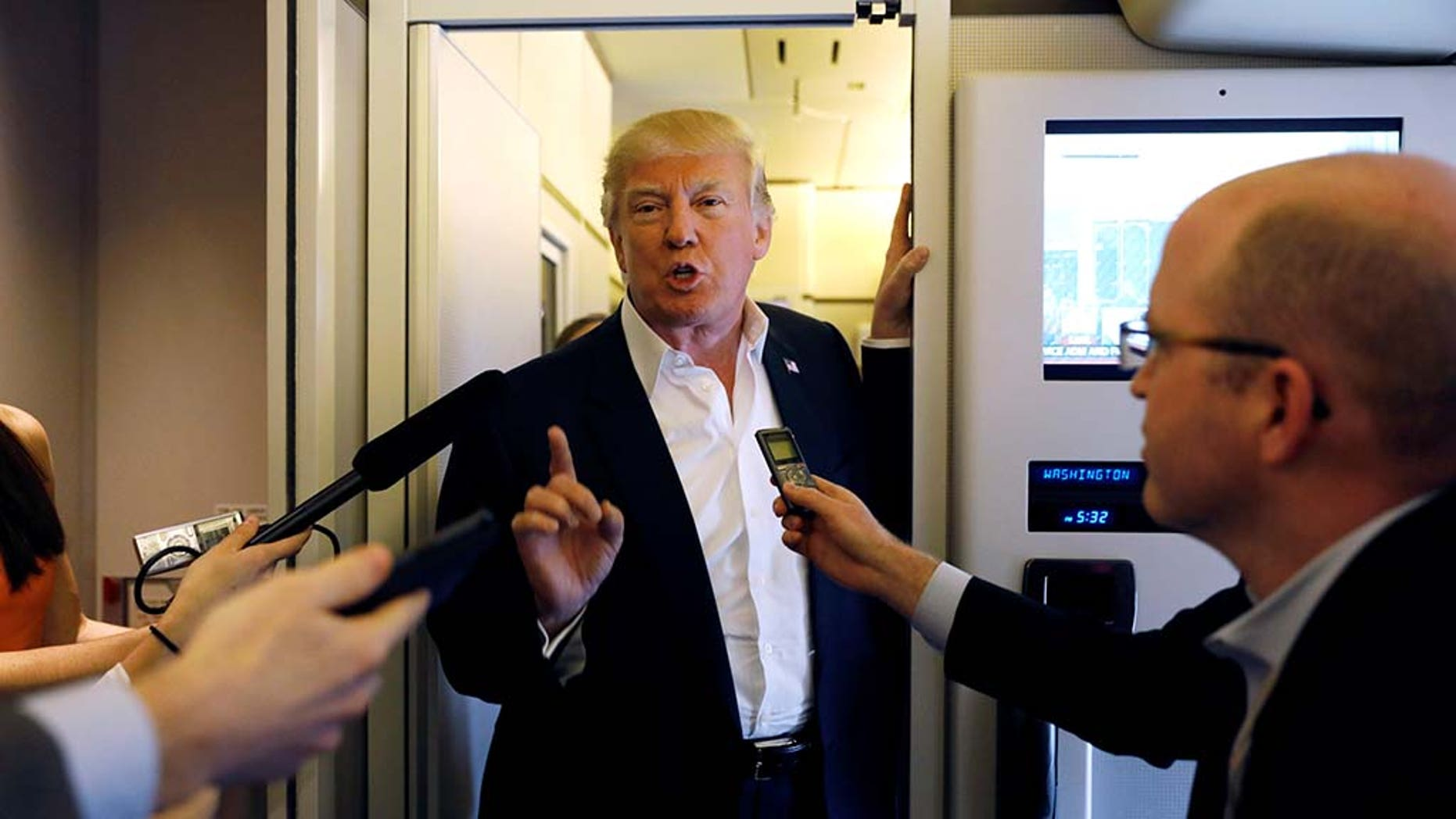 "U.S. President Donald Trump speaks with reporters aboard Air Force One on his way to a ""Make America Great Again"" rally at Orlando Melbourne International Airport in Melbourne, Florida, U.S. February 18, 2017."