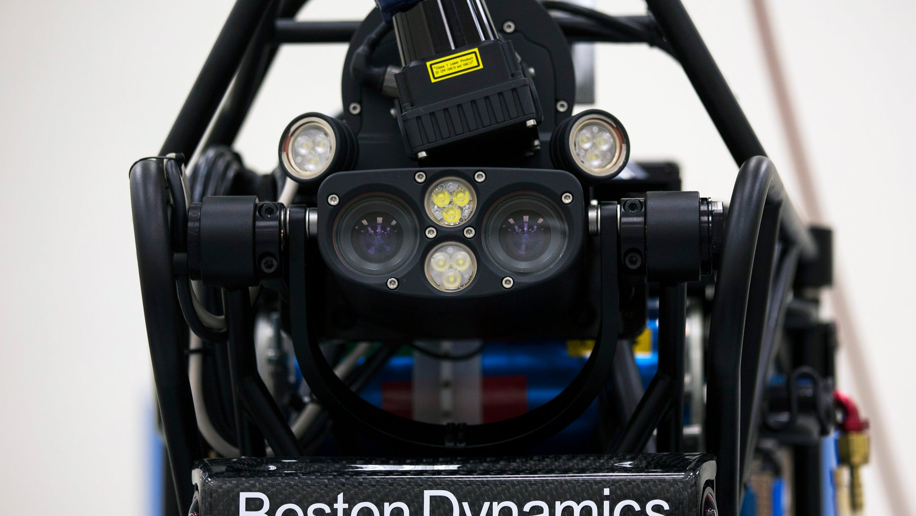 """File photo: Bipedal humanoid robot """"Atlas"""", primarily developed by the American robotics company Boston Dynamics, is presented to the media during a news conference at the University of Hong Kong October 17, 2013."""