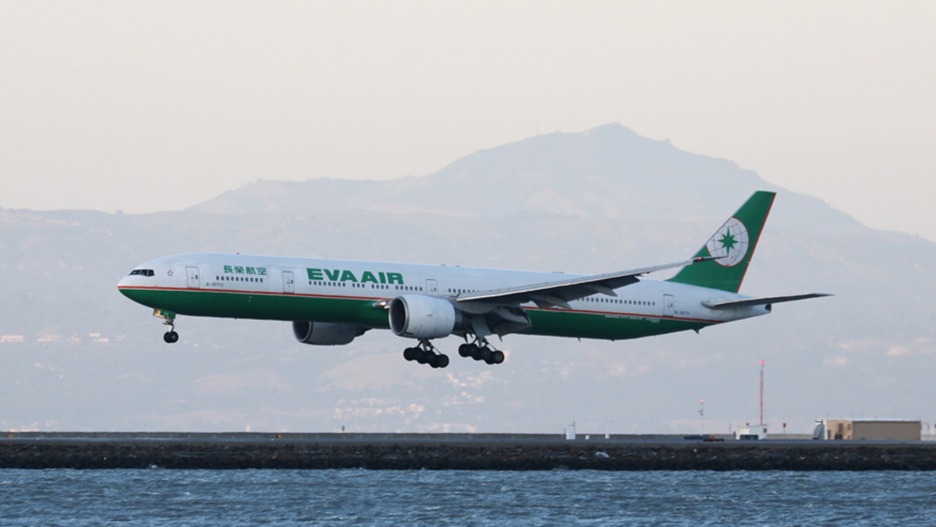 An Eva Air Boeing 777-300ER, with Tail Number B-16711, lands at San Francisco International Airport, San Francisco, California, April 11, 2015.   REUTERS/Louis Nastro - RTX19W22
