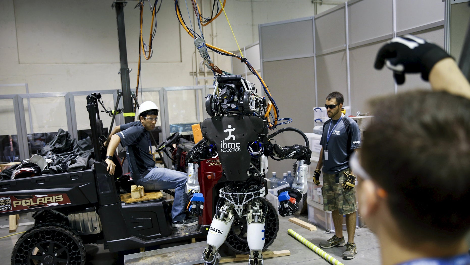 "File photo: The Team IHMC Robotics Atlas ""Running Man"" robot built by Boston Dynamics is readied in the team garage during the finals of the Defense Advanced Research Projects Agency (DARPA) Robotic Challenge in Pomona, California June 6, 2015. (REUTERS/Patrick T. Fallon)"