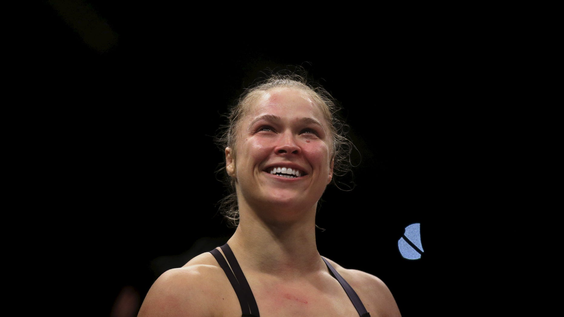 Ronda Rousey (R) of U.S celebrates after defeating Bethe Correia of Brazil during their Ultimate Fighting Championship (UFC) match, a professional mixed martial arts (MMA) competition in Rio de Janeiro, Brazil August 1, 2015.
