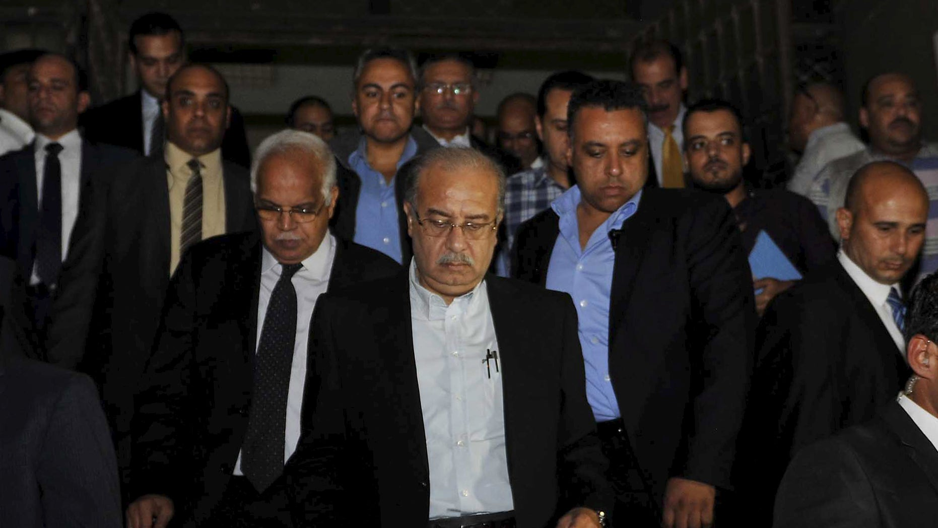 Egypt's Prime Minister Sherif Ismail, center, denounced the attack, officials said.