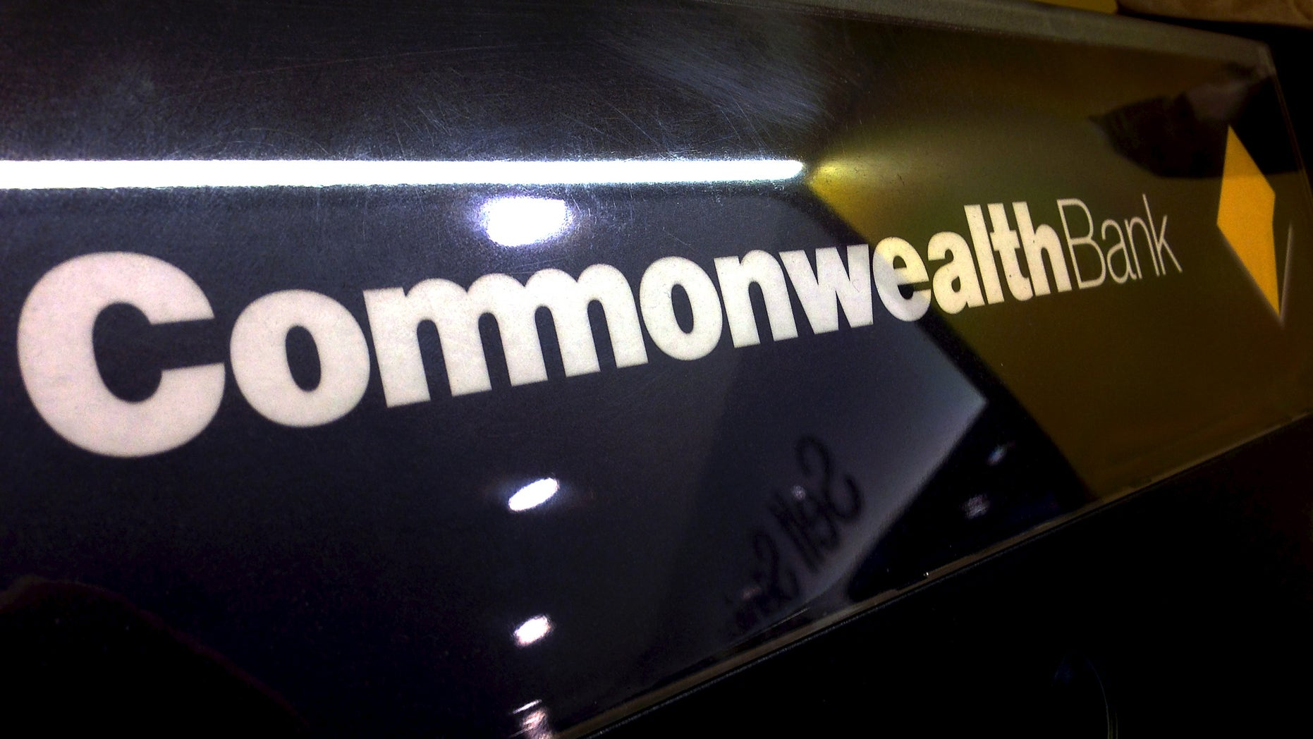 A Commonwealth Bank of Australia logo adorns the wall of a branch located in Sydney, Australia, November 5, 2015. The Commonwealth Bank of Australia (CBA), the country's No.2 lender by assets, on Thursday posted first quarter unaudited cash earnings of A$2.4 billion ($1.7 billion) while bad debt charges fell. Australia's four major banks - CBA, National Australia Bank, ANZ Banking Corp and Westpac - posted their sixth straight year of record profits but are preparing for their slowest earnings growth since the global financial crisis as the economy cools and stricter capital regulations bite.   REUTERS/David Gray - RTX1UT17