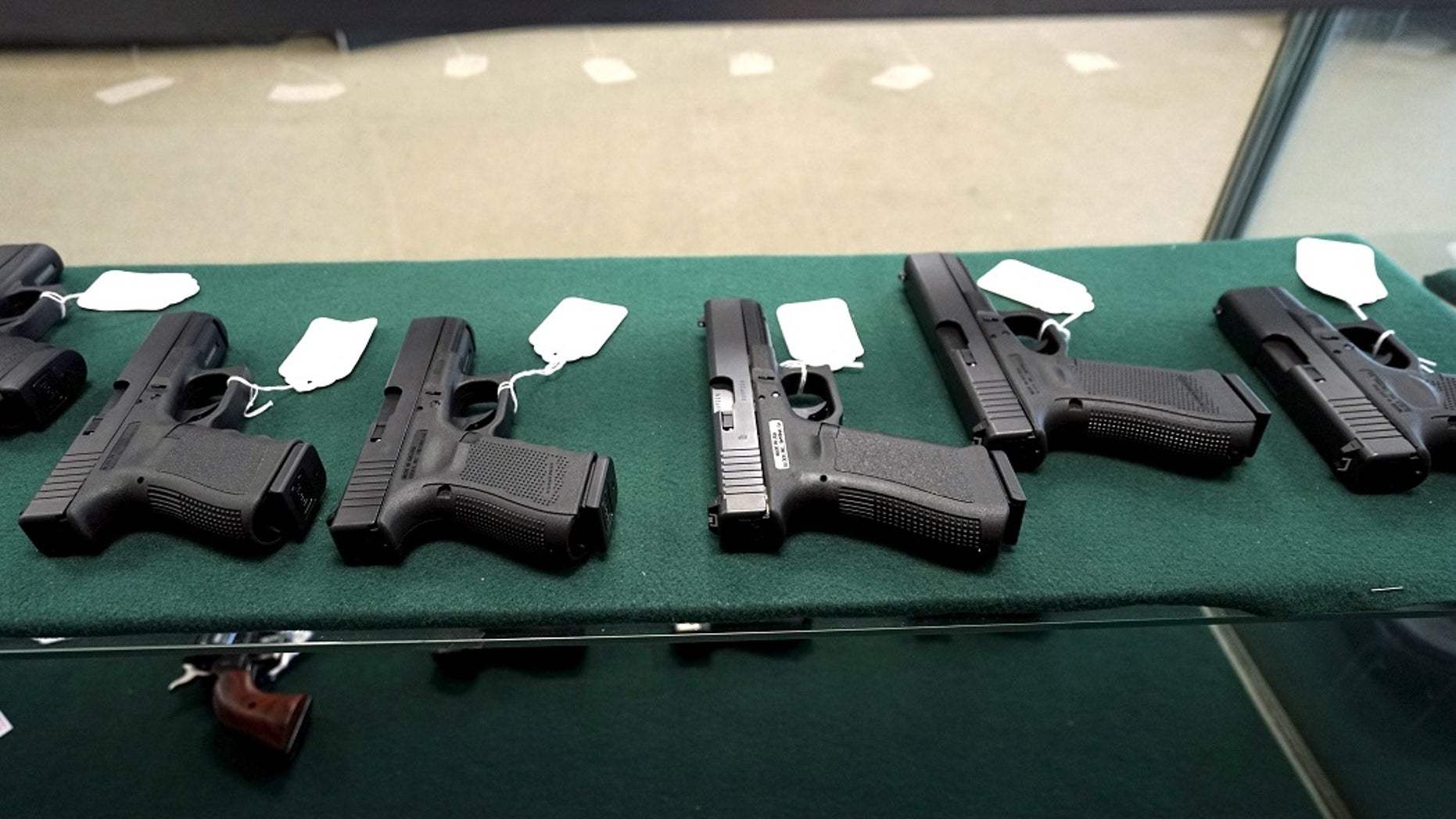 FILE -- A selection of Glock pistols are seen for sale.