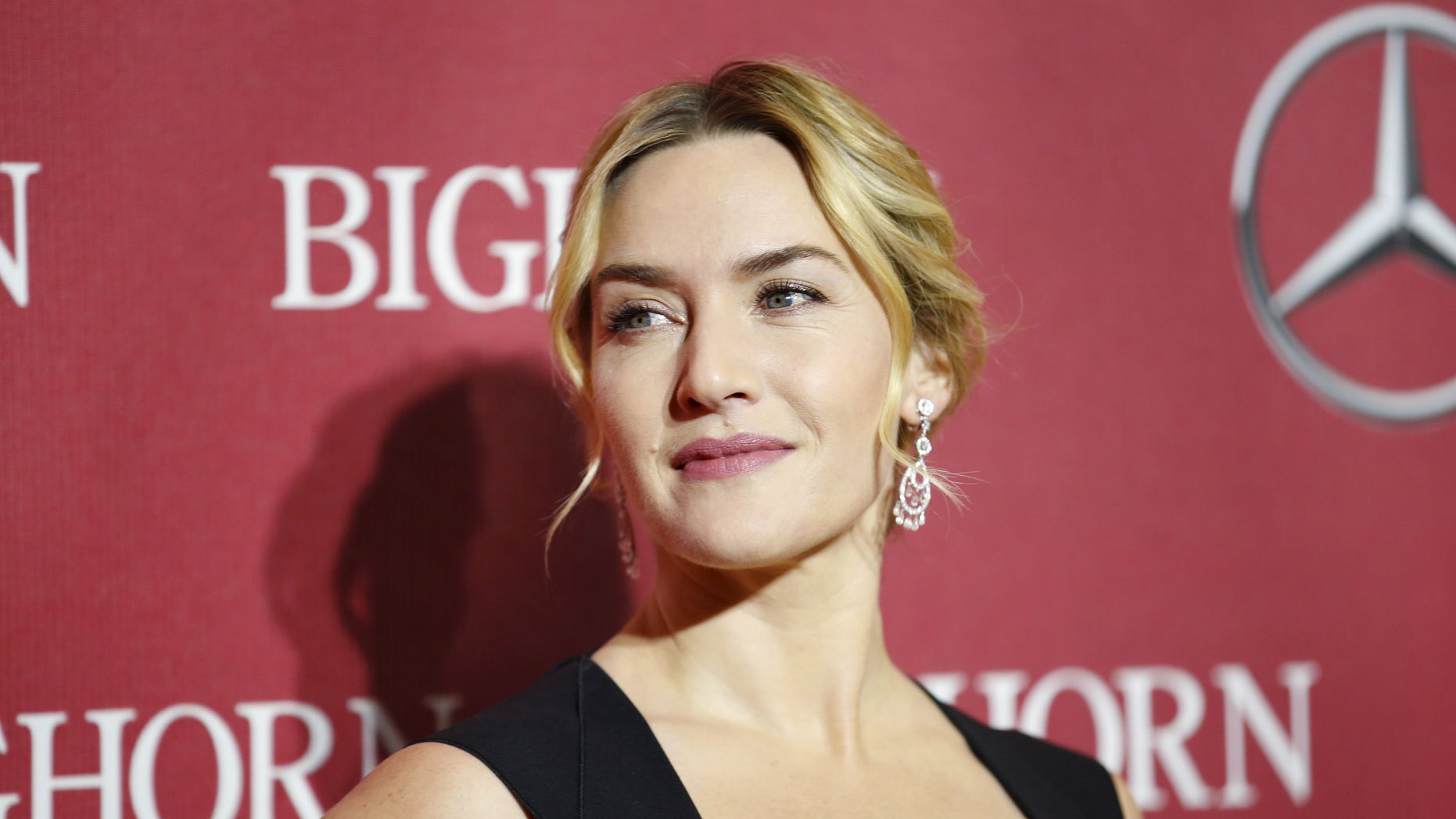 Actress Kate Winslet poses at the 27th Annual Palm Springs International Film Festival Awards Gala in Palm Springs, California, January 2, 2016. REUTERS/Danny Moloshok - RTX20U4Q