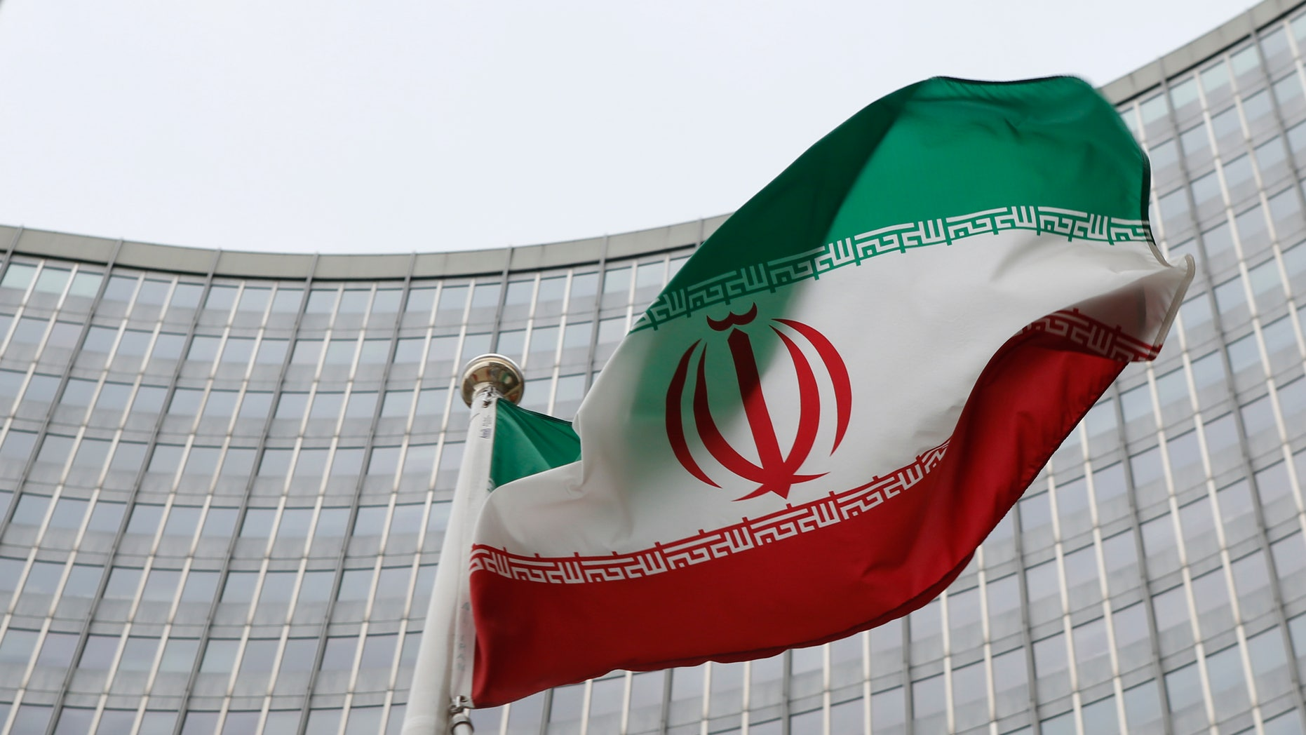 Jan. 15, 2016: An Iranian flag flutters in front of the International Atomic Energy Agency headquarters in Vienna, Austria. (REUTERS)