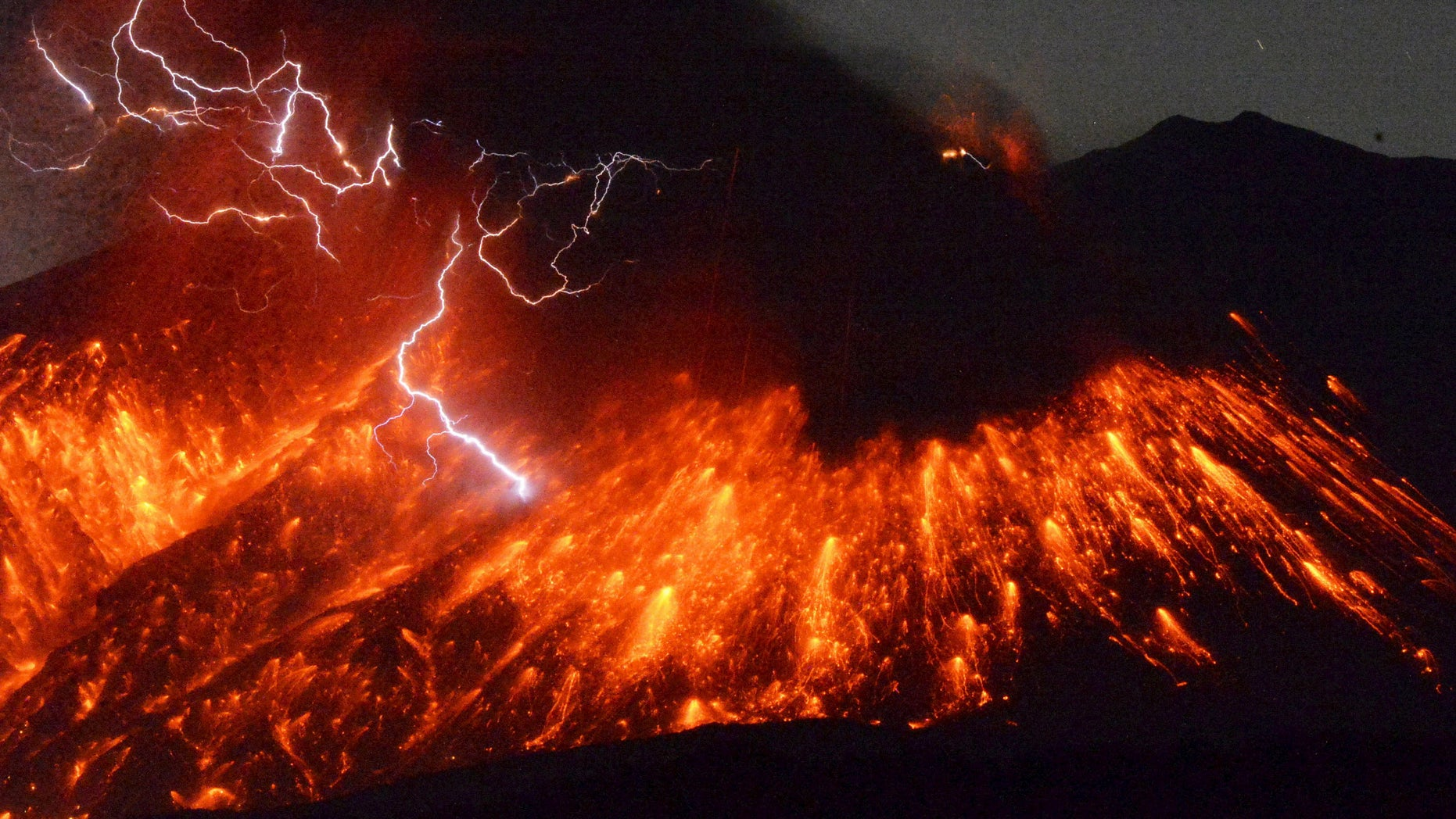 Volcanic lightning is seen at an eruption of Mount Sakurajima, in this photo taken from Tarumizu city, Kagoshima prefecture, southwestern Japan, taken by Kyodo February 5, 2016.