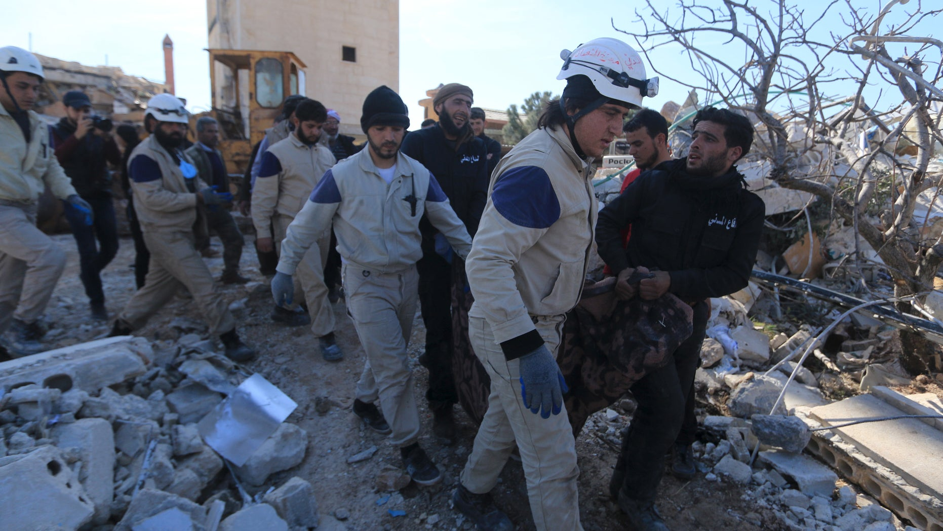 Feb 16., 2016: People and Civil Defense members carry a victim from a destroyed Doctors Without Borders hospital in Syria. (Reuters)