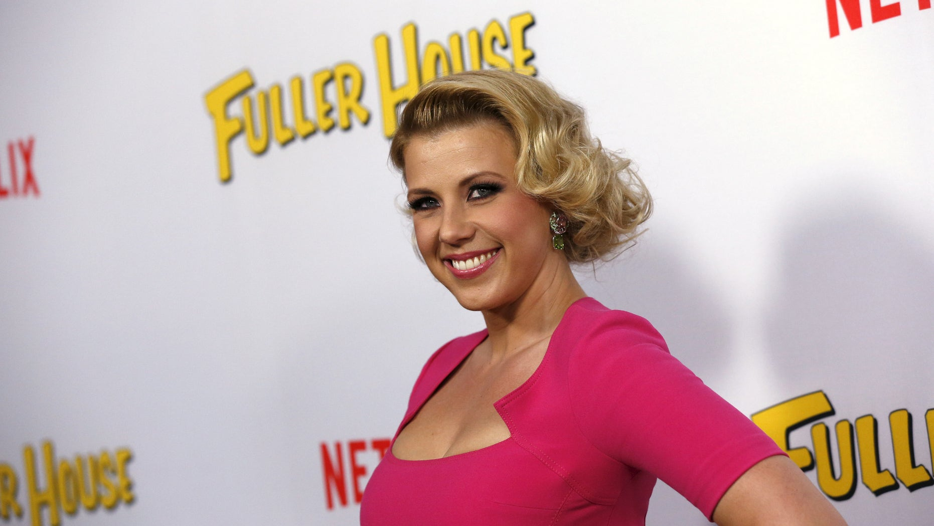 """Cast member Jodie Sweetin poses at the premiere for the Netflix television series """"Fuller House"""" at The Grove in Los Angeles, California February 16, 2016."""