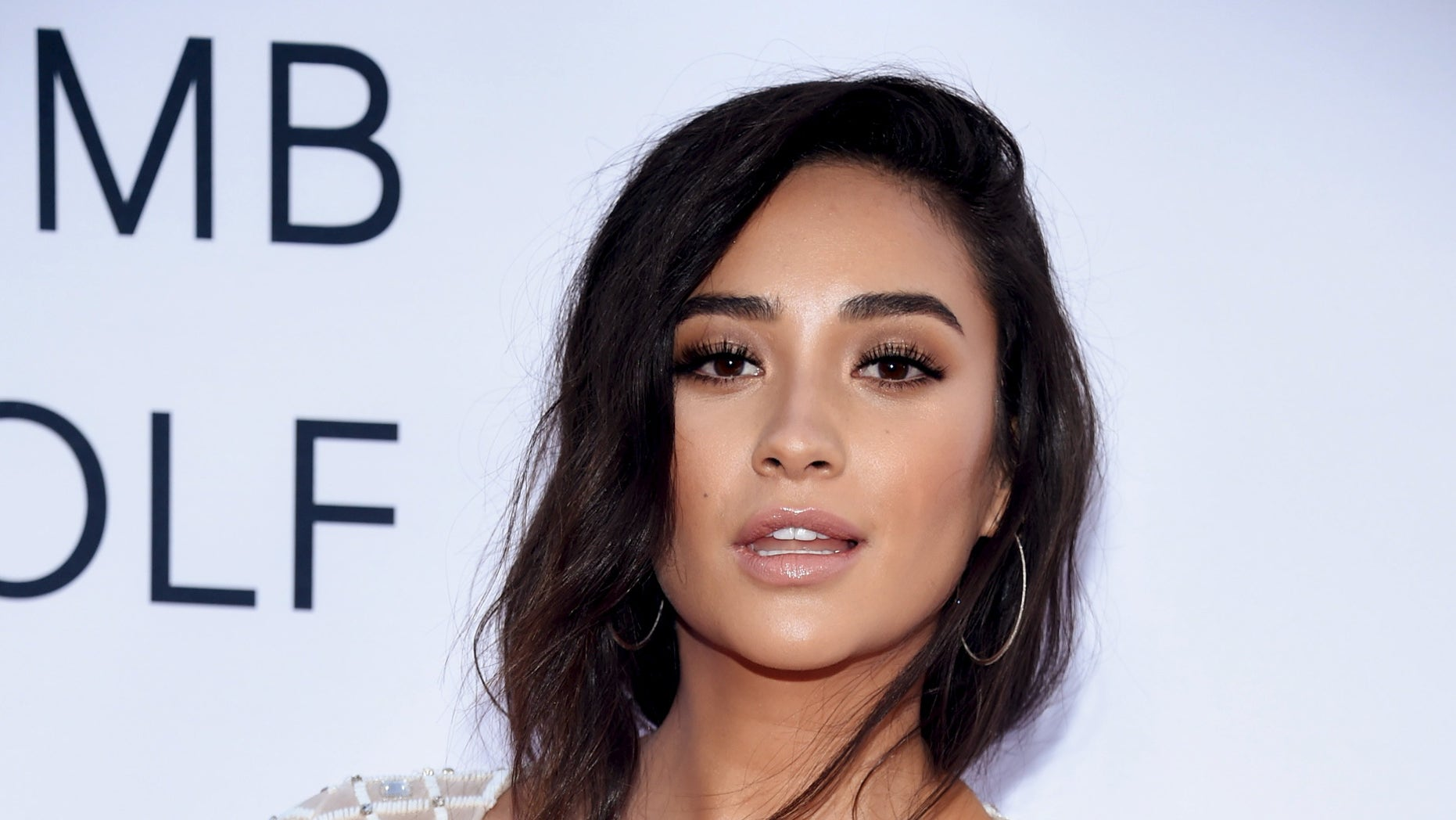 """Cast member Shay Mitchell attends the premiere of """"Mother's Day"""" in Los Angeles April 13, 2016. REUTERS/Phil McCarten - RTX29VHR"""