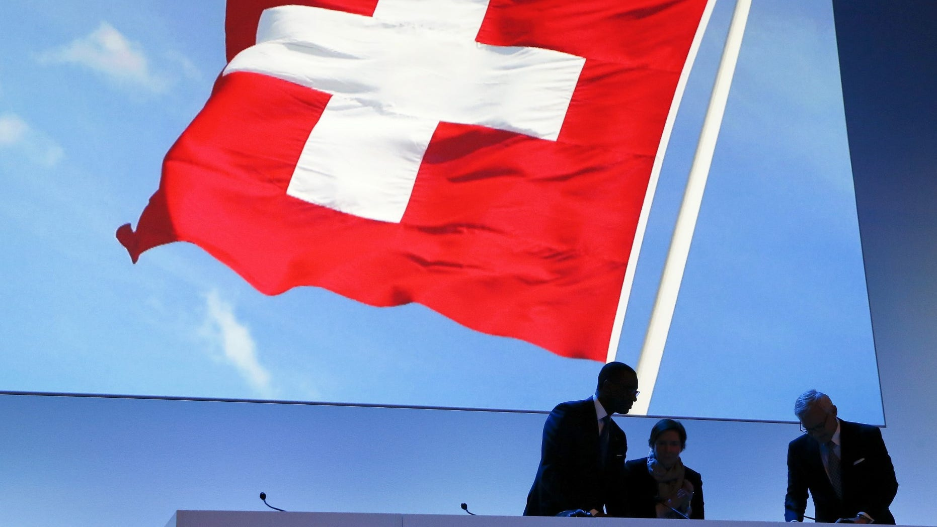 FILE -- Switzerland's national flag is seen in the background.