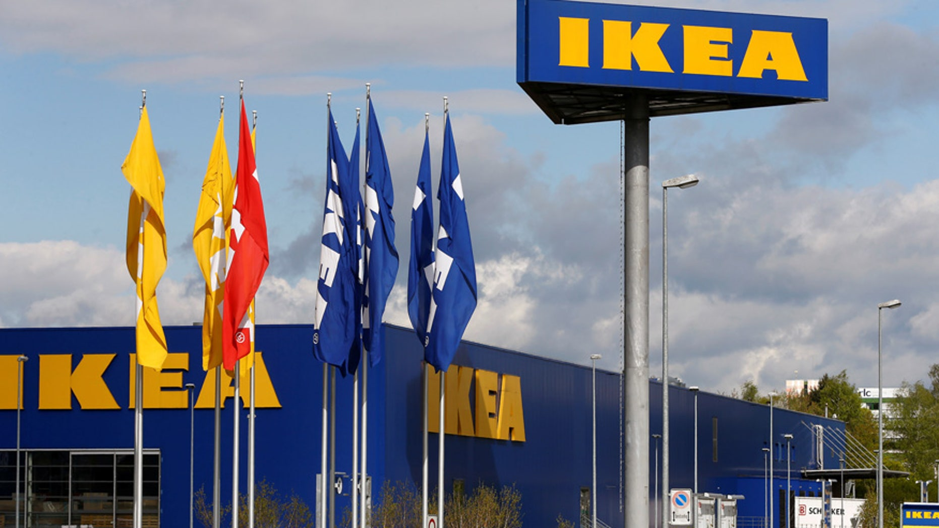 The company's logo is seen outside of an IKEA Group store in Spreitenbach, Switzerland April 27, 2016. REUTERS/Arnd Wiegmann - RTX2C60C
