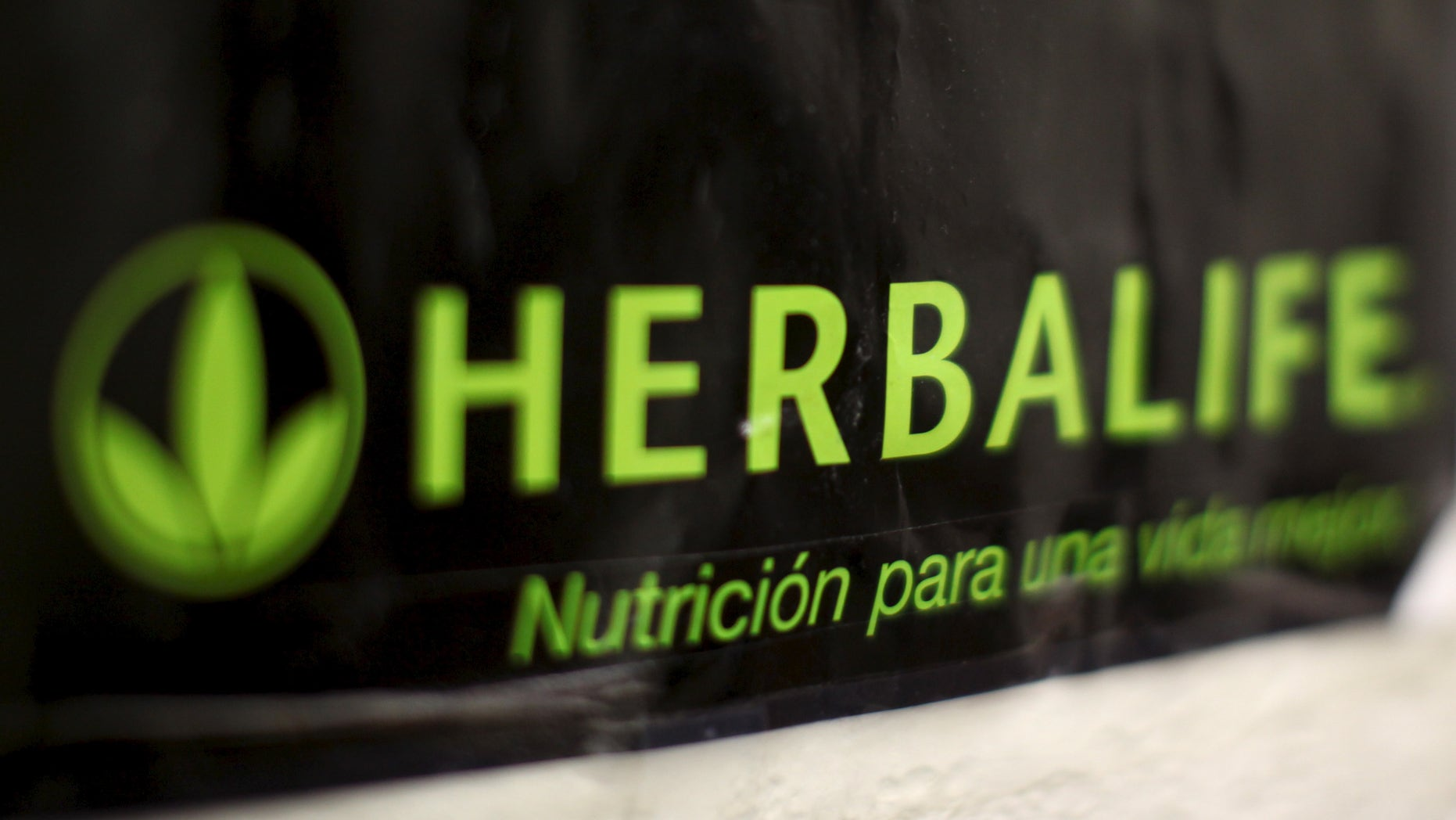 An Herbalife logo is shown on a poster at a clinic in the Mission District in San Francisco, California April 29, 2013.   REUTERS/Robert Galbraith/File Photo          GLOBAL BUSINESS WEEK AHEAD PACKAGE - SEARCH 'BUSINESS WEEK AHEAD MAY 2'  FOR ALL IMAGES - RTX2CDI4