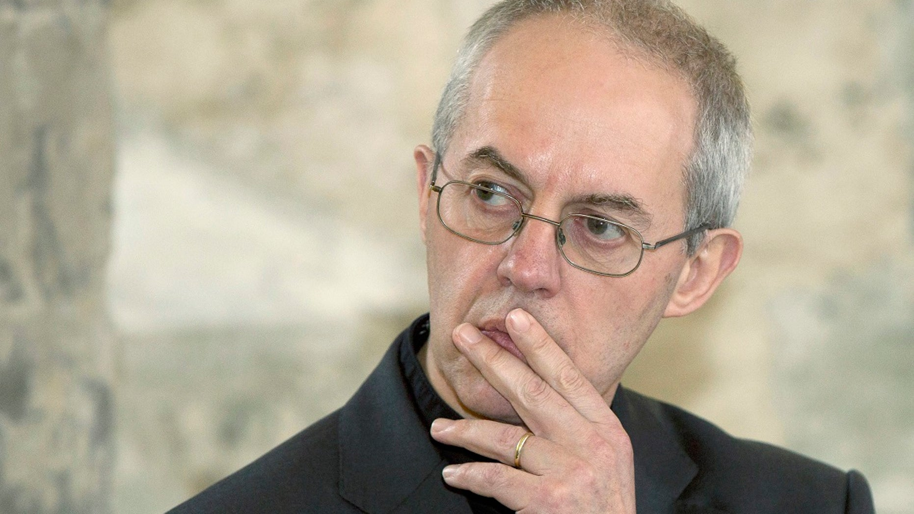 The Archbishop of Canterbury Justin Welby speaks during a news conference at Lambeth Palace in London February 20, 2014.   REUTERS/Neil Hall  - RTX2FQLQ