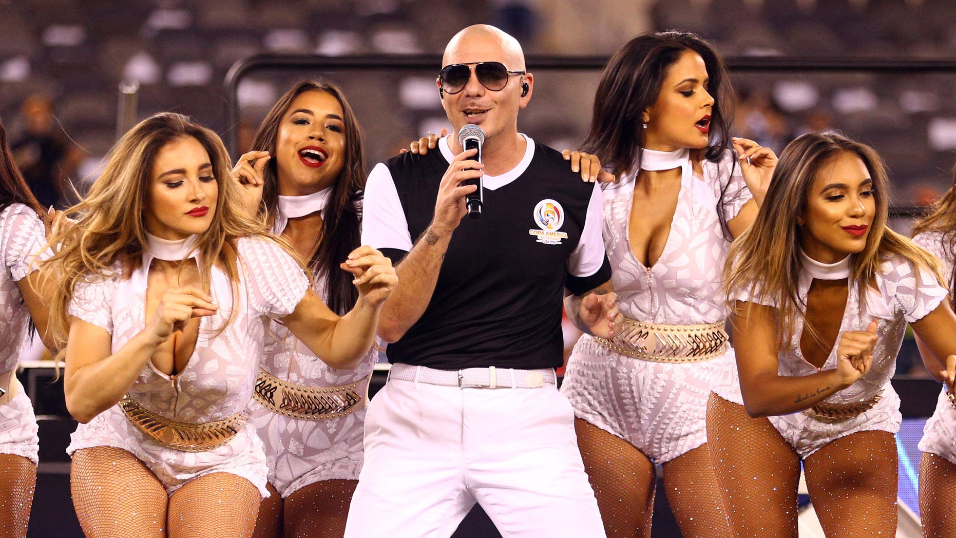 Jun 26, 2016; East Rutherford, NJ, USA; Recording artist Pitbull performs after the championship match of the 2016 Copa America Centenario soccer tournament at MetLife Stadium. Chile defeated Argentina 0-0 (4-2). Mandatory Credit: Brad Penner-USA TODAY Sports - RTX2IDRC