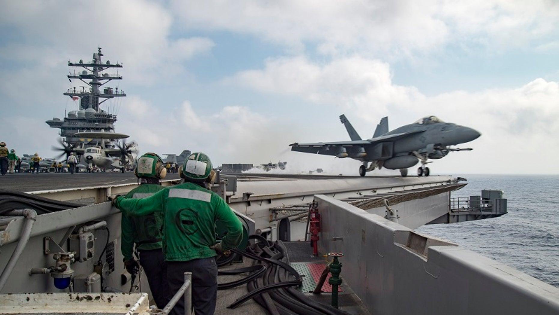 FILE -- A U.S. Navy F/A-18E Super Hornet launches from the flight deck of the aircraft carrier USS Dwight D. Eisenhower (CVN 69) in the Mediterranean Sea June 28, 2016.
