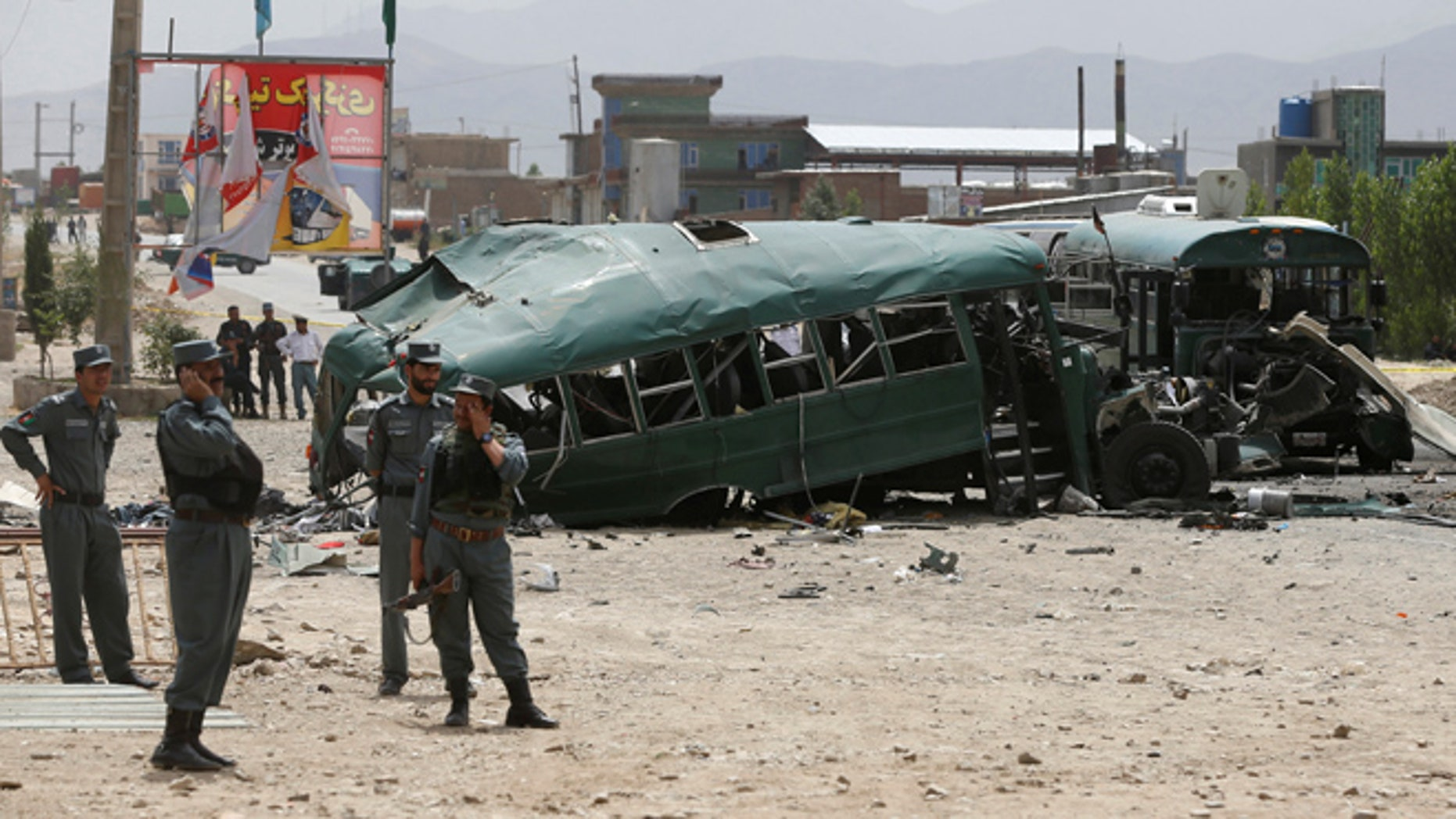 Afghan security forces inspect the damage on a bus that was hit by suicide bombers at the site of an attack on the western outskirts of Kabul, Afghanistan June 30, 2016. REUTERS/Omar Sobhani