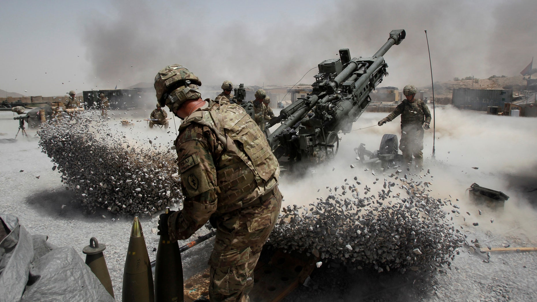File photo: U.S. Army soldiers from the 2nd Platoon, B battery 2-8 field artillery, fire a howitzer artillery piece at Seprwan Ghar forward fire base in Panjwai district, Kandahar province southern Afghanistan, June 12, 2011.