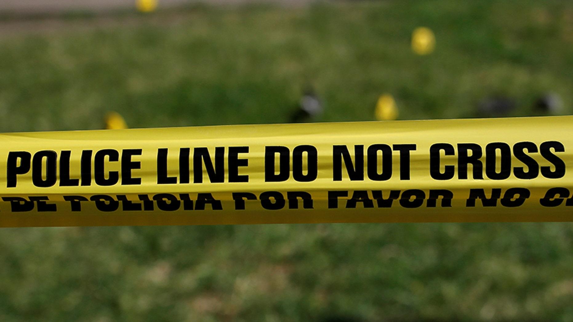 File photo - Police tape marks a crime scene in Dallas in 2016.