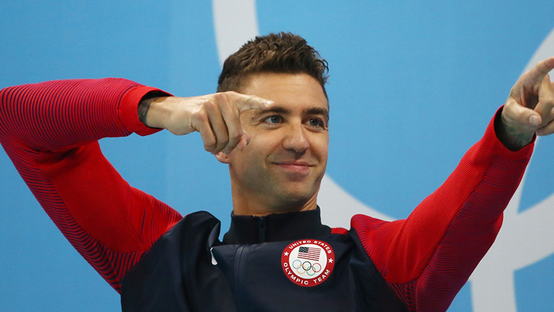 U.S. Olympic gold medal swimmer Anthony Ervin took a knee during the national anthem after he anchored Team USA's mixed 200-meter medley race in Brazil.