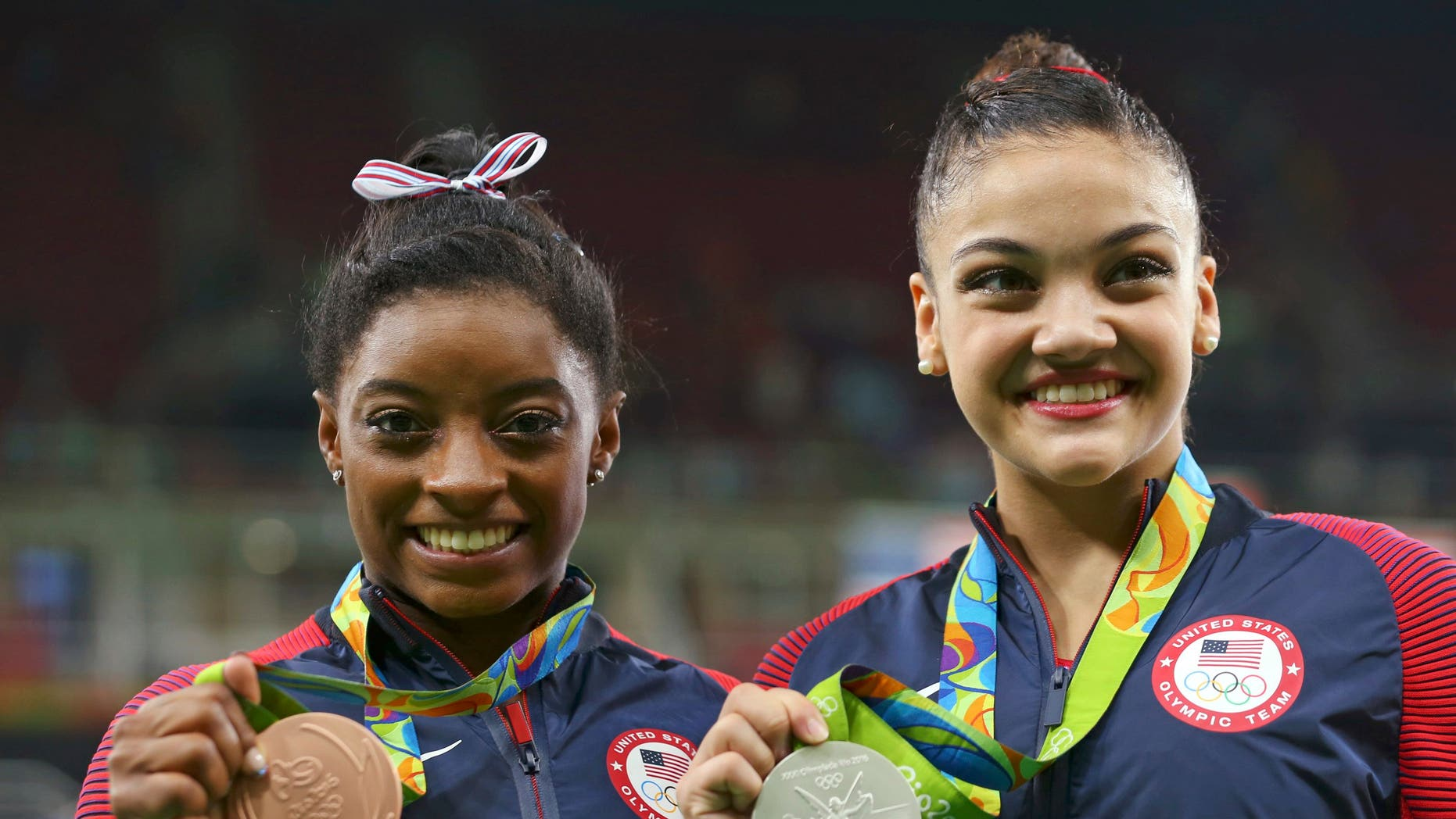 Silver medalist Laurie Hernandez (USA) of USA (R) and bronze medalist Simone Biles (USA) of USA (L) pose with their medals.