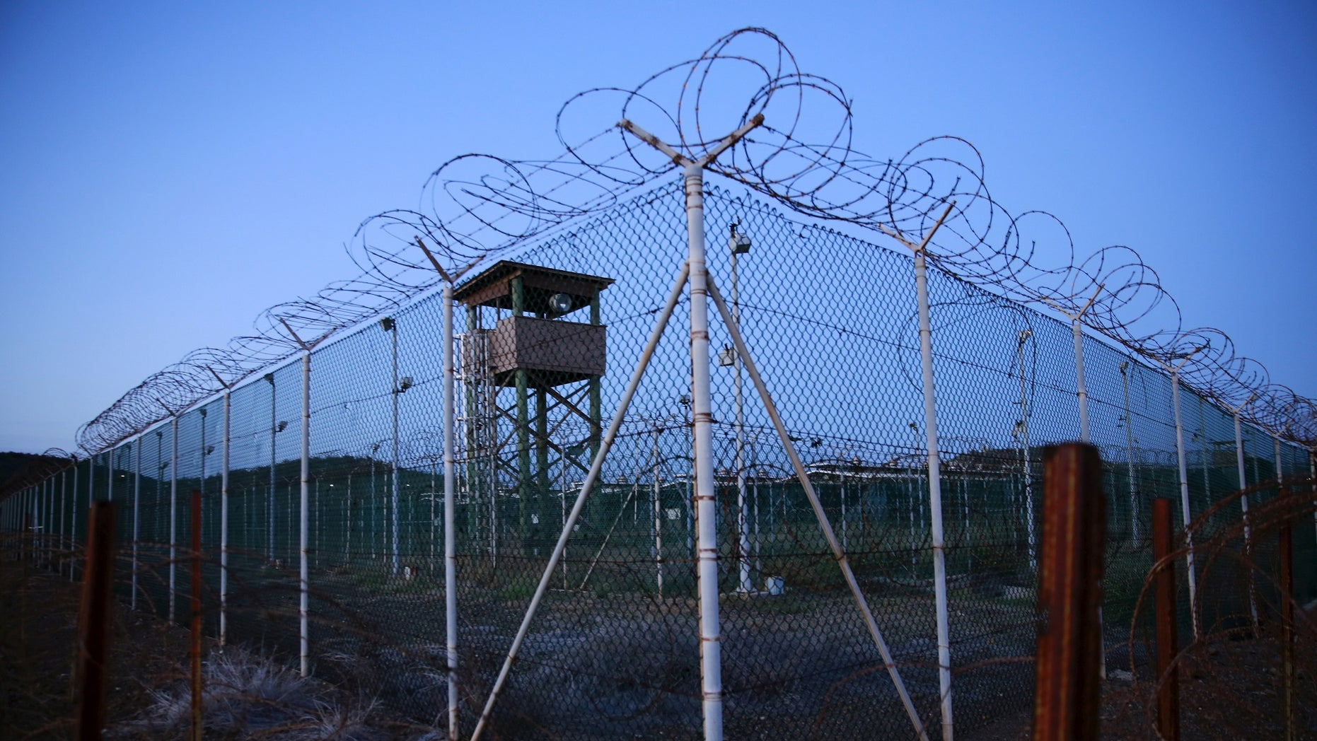 FILE PHOTO -  Chain link fence and concertina wire surrounds a deserted guard tower within Joint Task Force Guantanamo's Camp Delta at the U.S. Naval Base in Guantanamo Bay, Cuba March 21, 2016.  REUTERS/Lucas Jackson/File Photo     TPX IMAGES OF THE DAY      - S1AETVRIXQAA