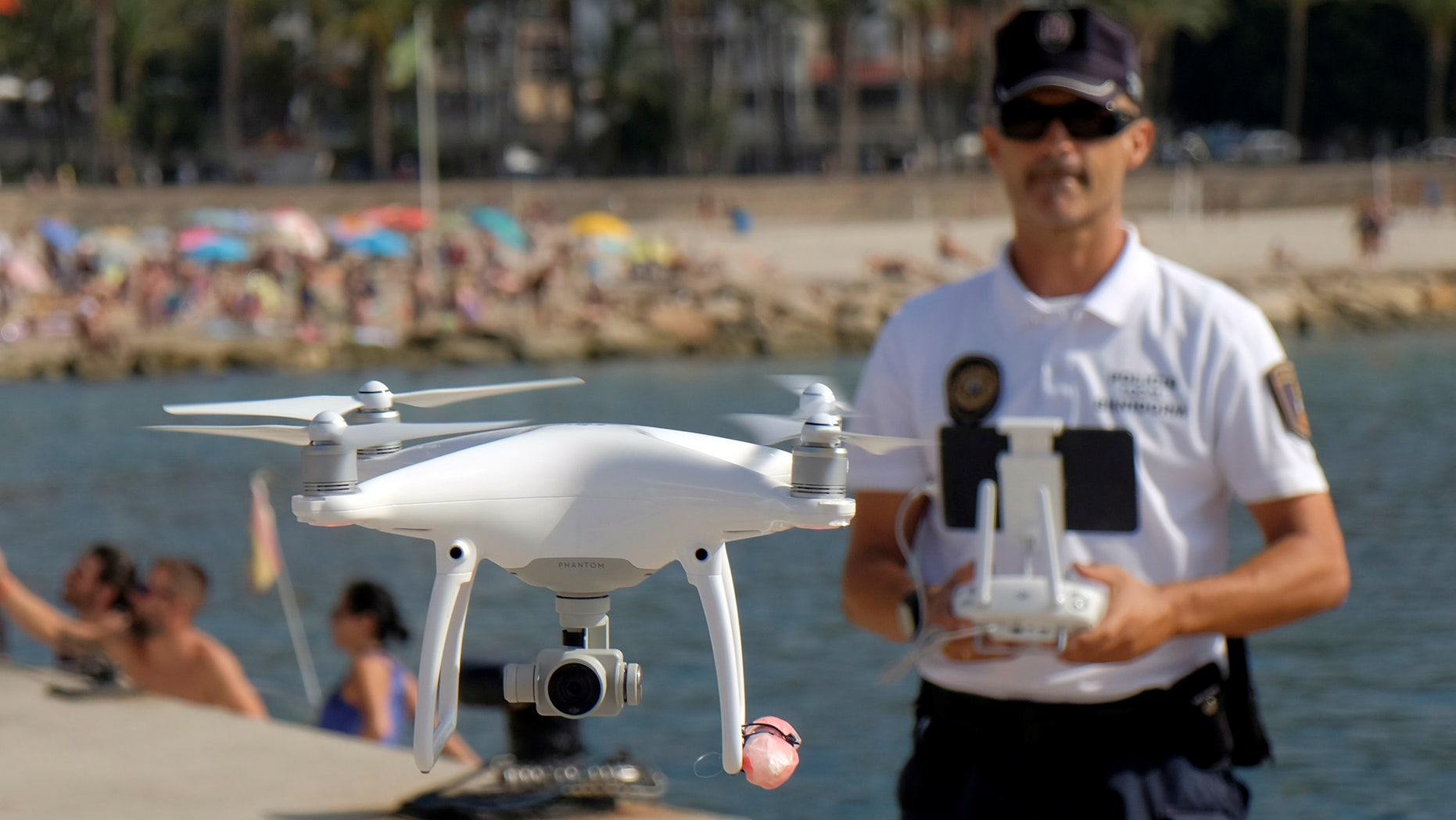 File photo: Local police officer Agustin Mirete controls a drone equipped with a camera used for surveillance tasks in the Poniente beach at the eastern costal town of Benidorm, Spain, August 18, 2016. (REUTERS/Heino Kalis)
