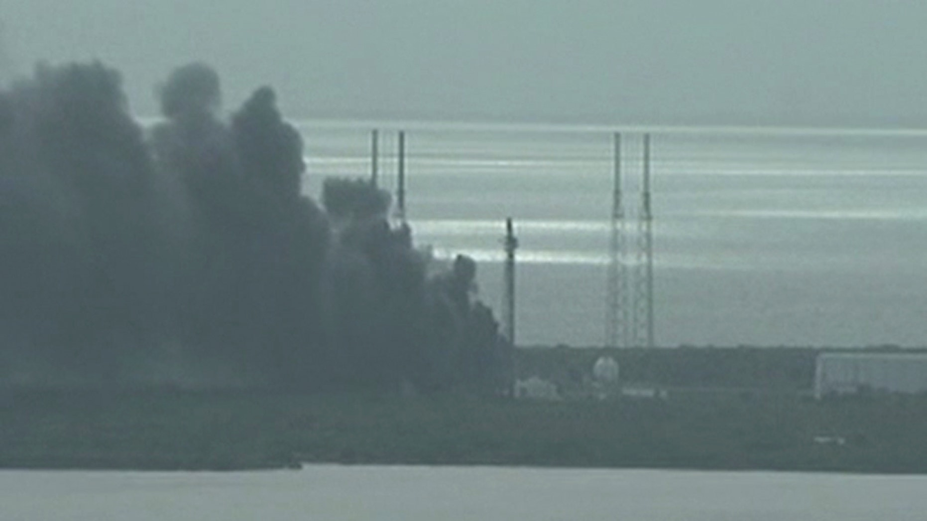 A still image taken from video of smoke rising on the launch site of SpaceX Falcon 9 rocket in Cape Canaveral, Florida, September 1, 2016.  (NASA TV/Handout via REUTERS)